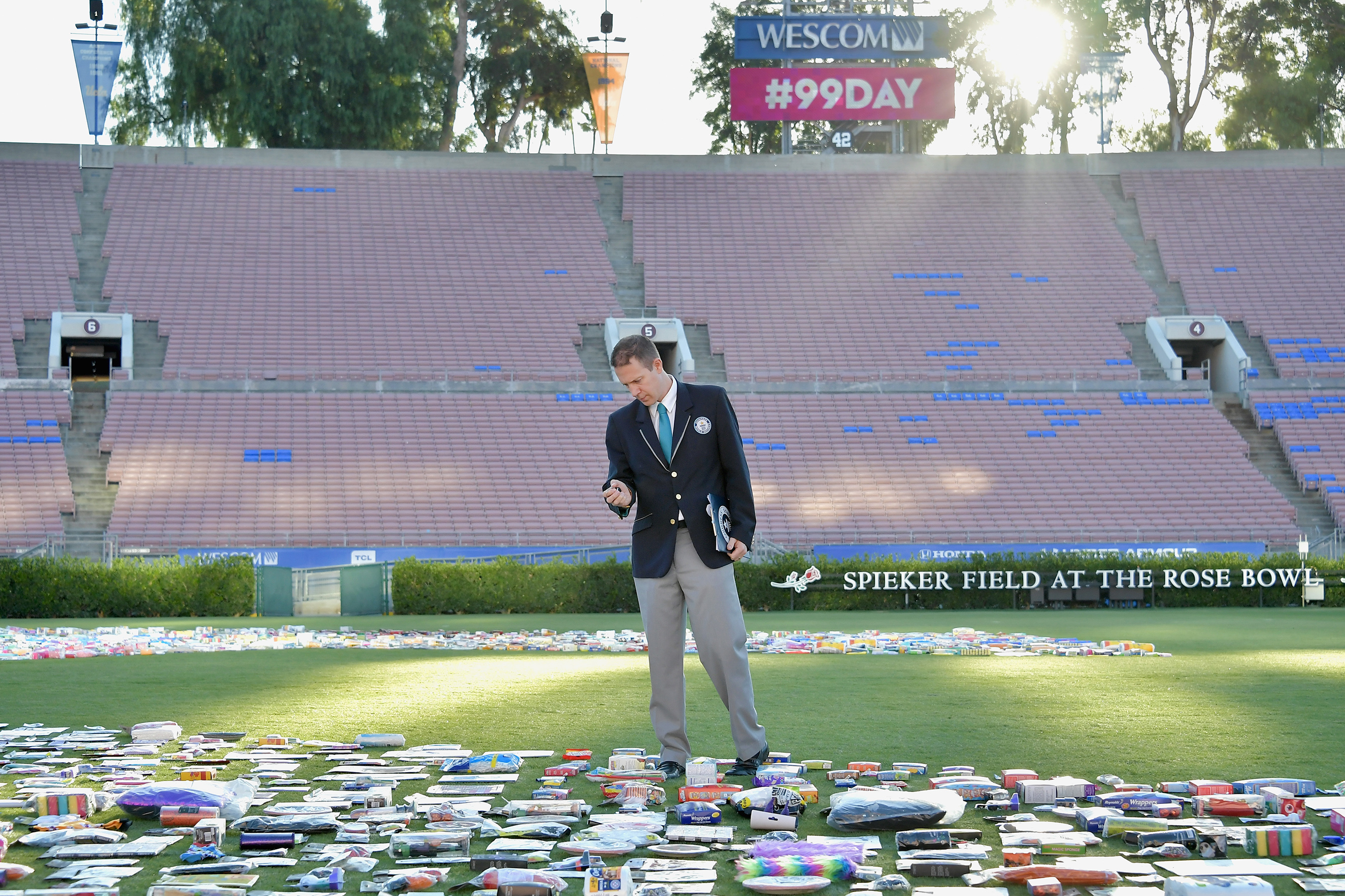 Guinness World Records Adjudicator Philip Robertson counts the final numbers for the 99 Cents Only Stores Guinness World Record title of Largest packaged product number at the Rose Bowl Stadium on Sept. 9, 2018 in Pasadena, California.