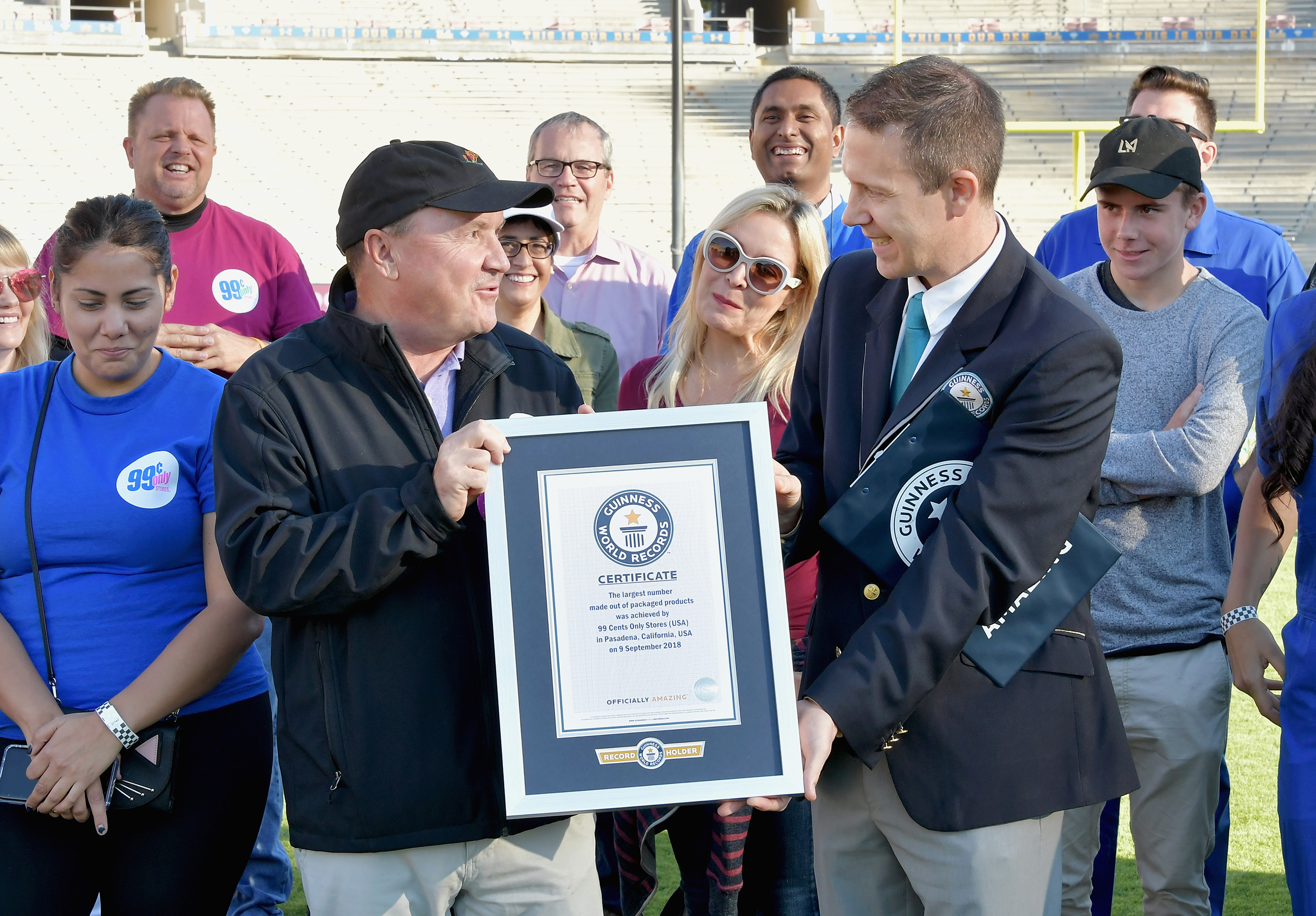 Guinness World Records Adjudicator Philip Robertson (R) presents CEO of 99 Cents Only Stores Jack Sinclair with the certificate for Largest packaged product number at the Rose Bowl Stadium on Sept. 9, 2018 in Pasadena, California.