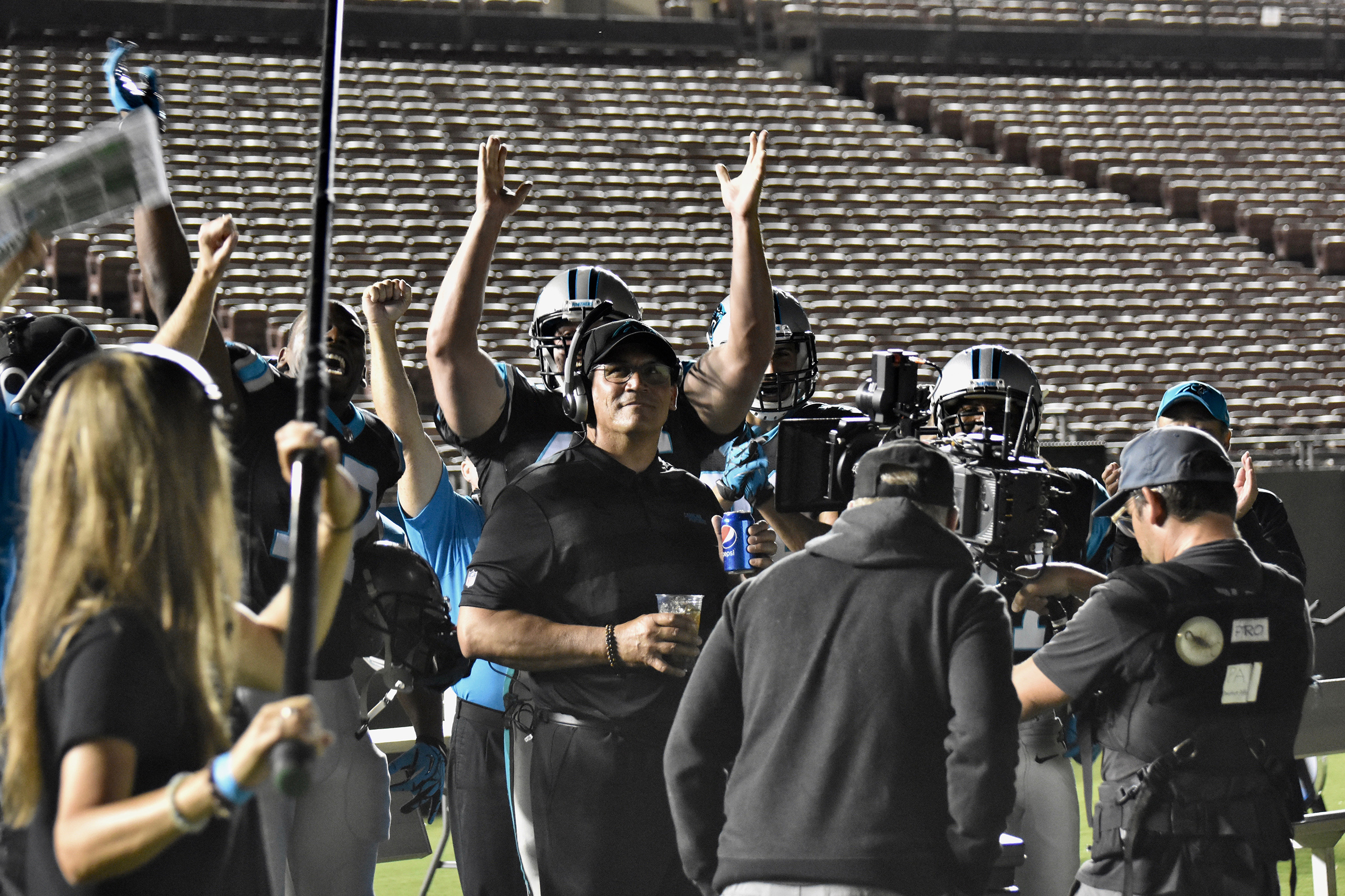 Behind-the-scenes photo of Carolina Panthers Head Coach Ron Rivera on set of Pepsi's 'Ice the Kicker' commercial, debuting mid-September