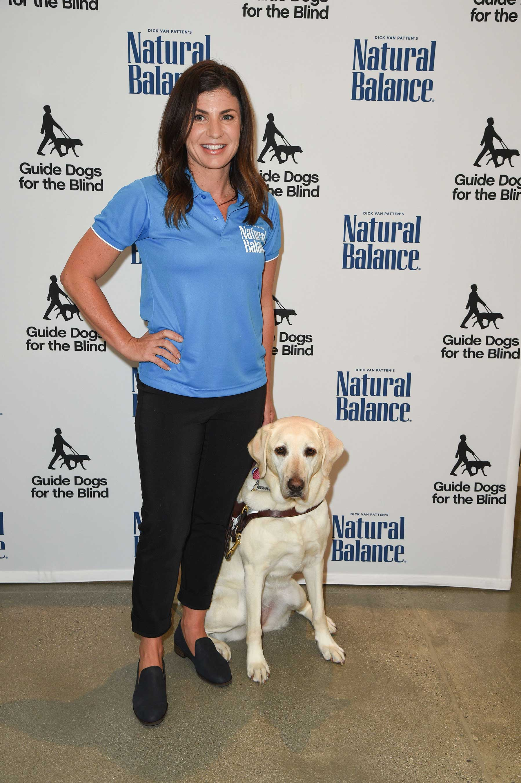 It's a pawty! Three-time Paralympic Medalist, Danelle Umstead and her guide dog, Aziza, celebrate the 10-year anniversary of National Guide Dog Month with Natural Balance premium pet food brand at the Kimpton Everly Hotel in Los Angeles