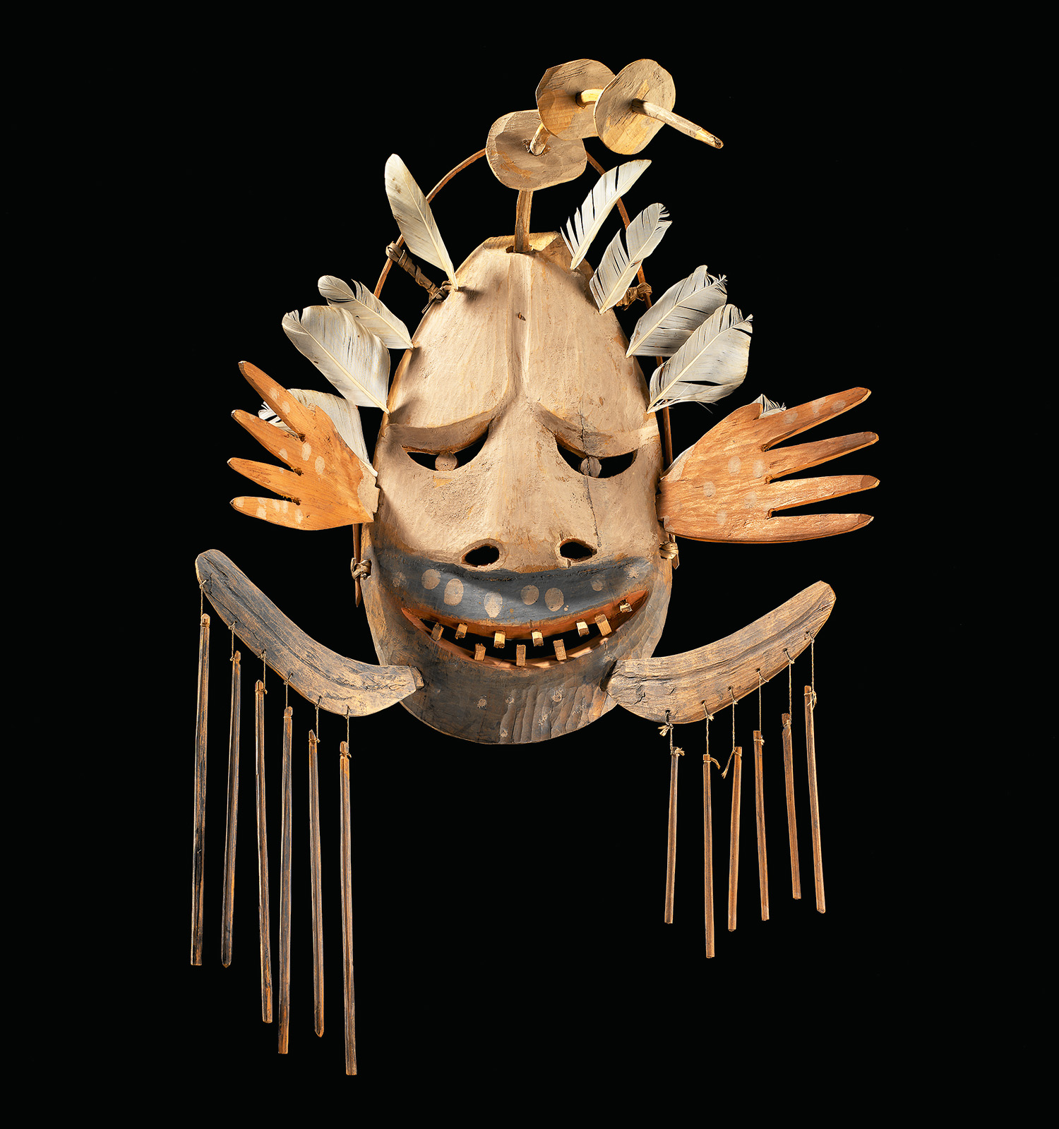 Central Yup'ik, Napaskiaq Village, Kuskokwim River, Alaska. Wanelnguq dance mask c. 1900. Wood, feathers, pigment. Collection of the National Museum of the American Indian, Smithsonian Institution, 9/3432. Photo by NMAI Photo Services.