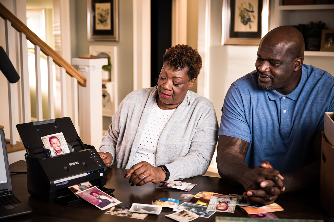 Lucille and Shaquille O'Neal easily and quickly convert cherished photographs to digital with the Epson FastFoto