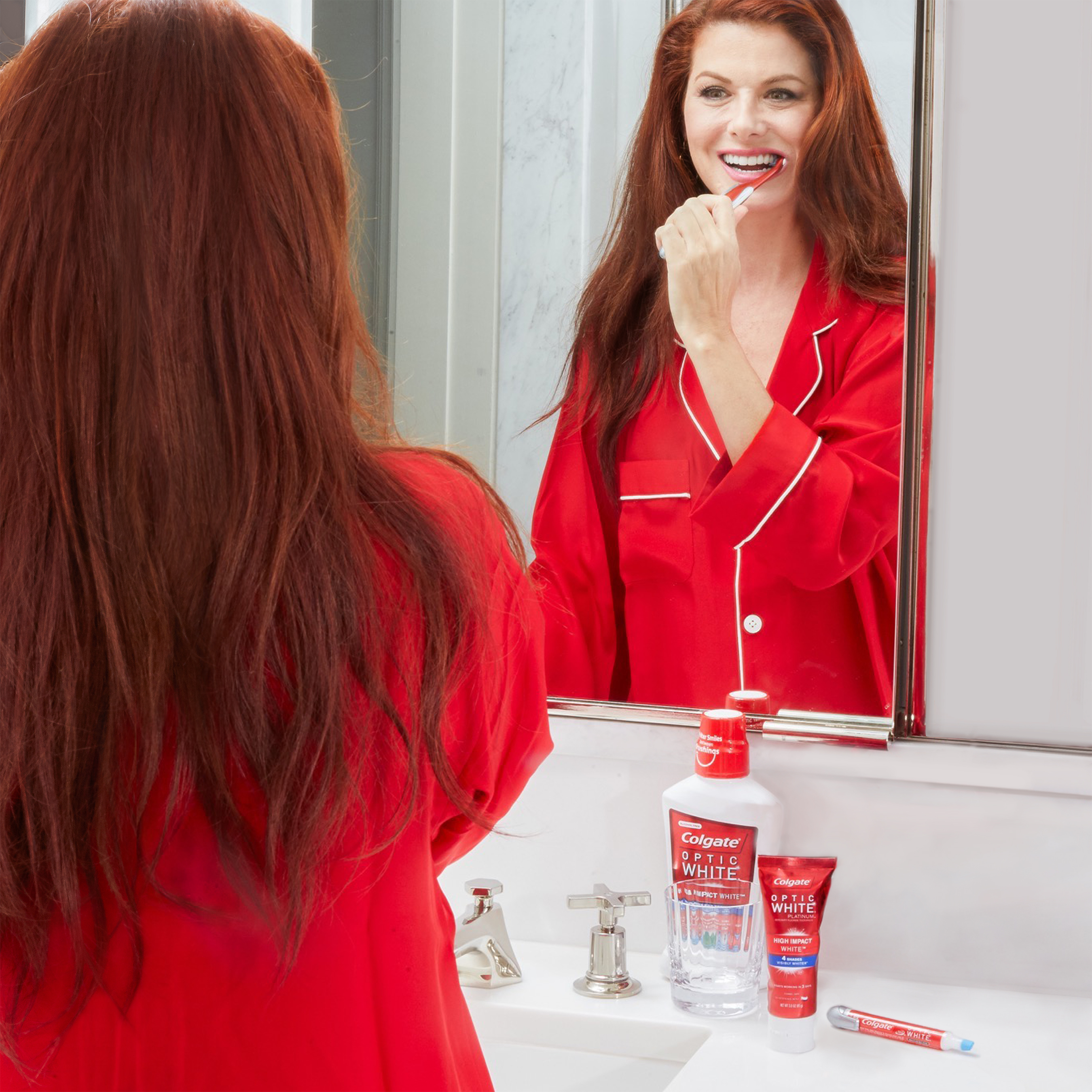 Actress Debra Messing reveals that the key to her iconic bright, white smile is Colgate Optic White High Impact White.