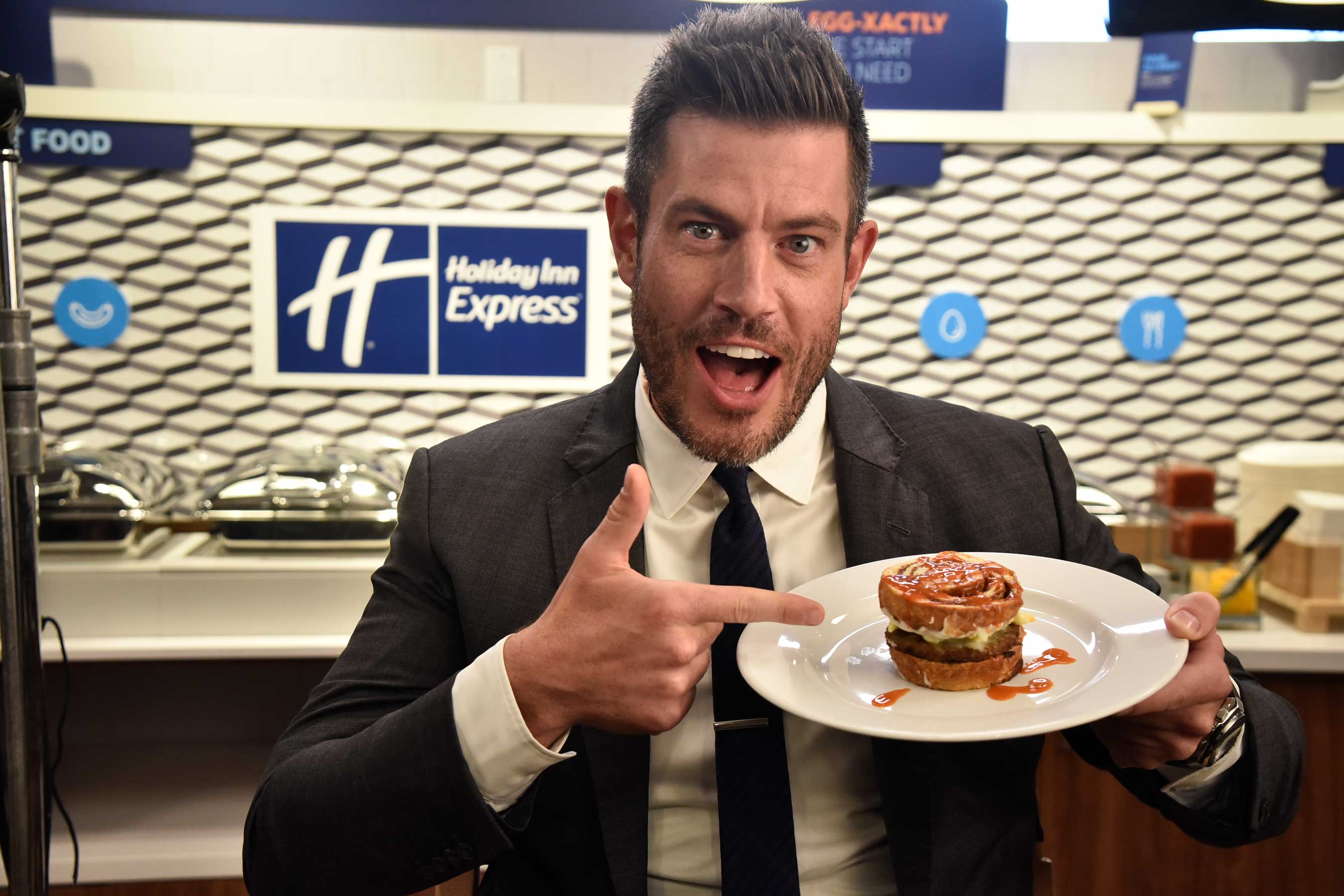 Jesse Palmer with The Quarterback Slider, a split cinnamon roll with eggs, sausage and hot sauce.