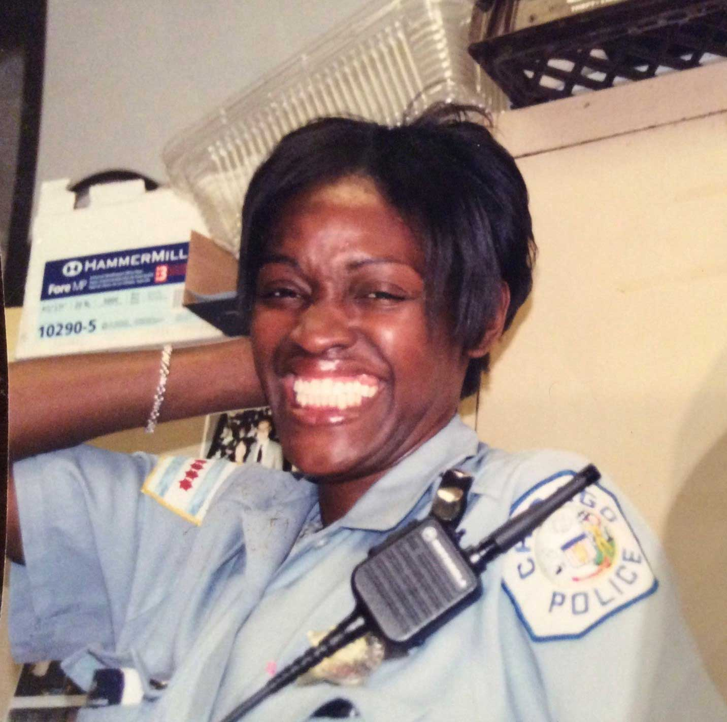 The new Michele Clark weight room is dedicated and named in honor of Carolyn Brown, a Chicago Police officer who served onsite at the school and coached several school teams.