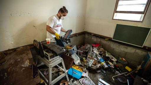 Volunteer cleaning up house hit by Hurricane Florence