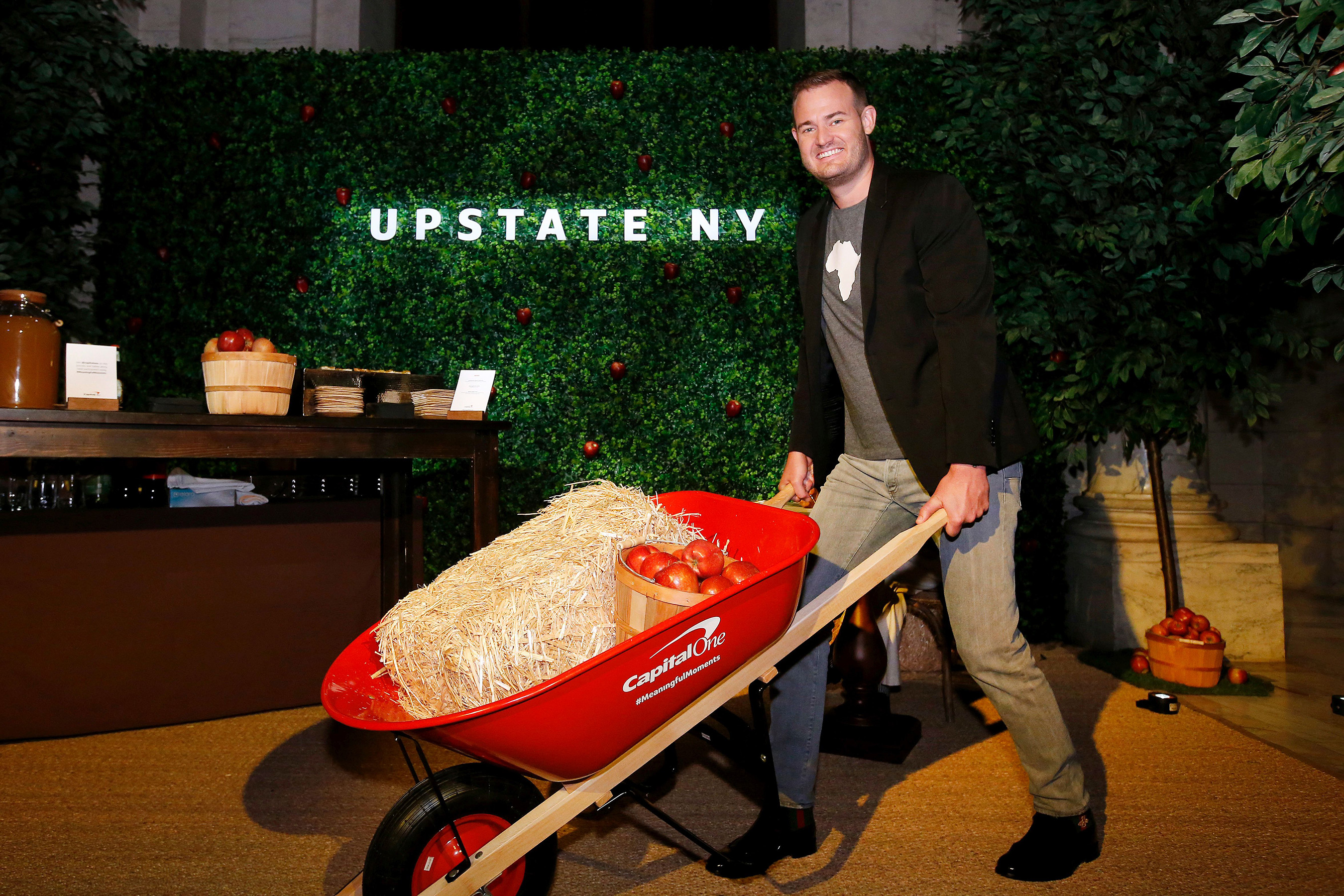 """Brian Kelly (""""The Points Guy"""") wheels his way through the Upstate New York pop-up experience at a launch event for the Purpose Project(SM) by Capital One®, Wednesday, October 24, 2018, in New York. (Jason DeCrow/AP Images for Capital One)"""