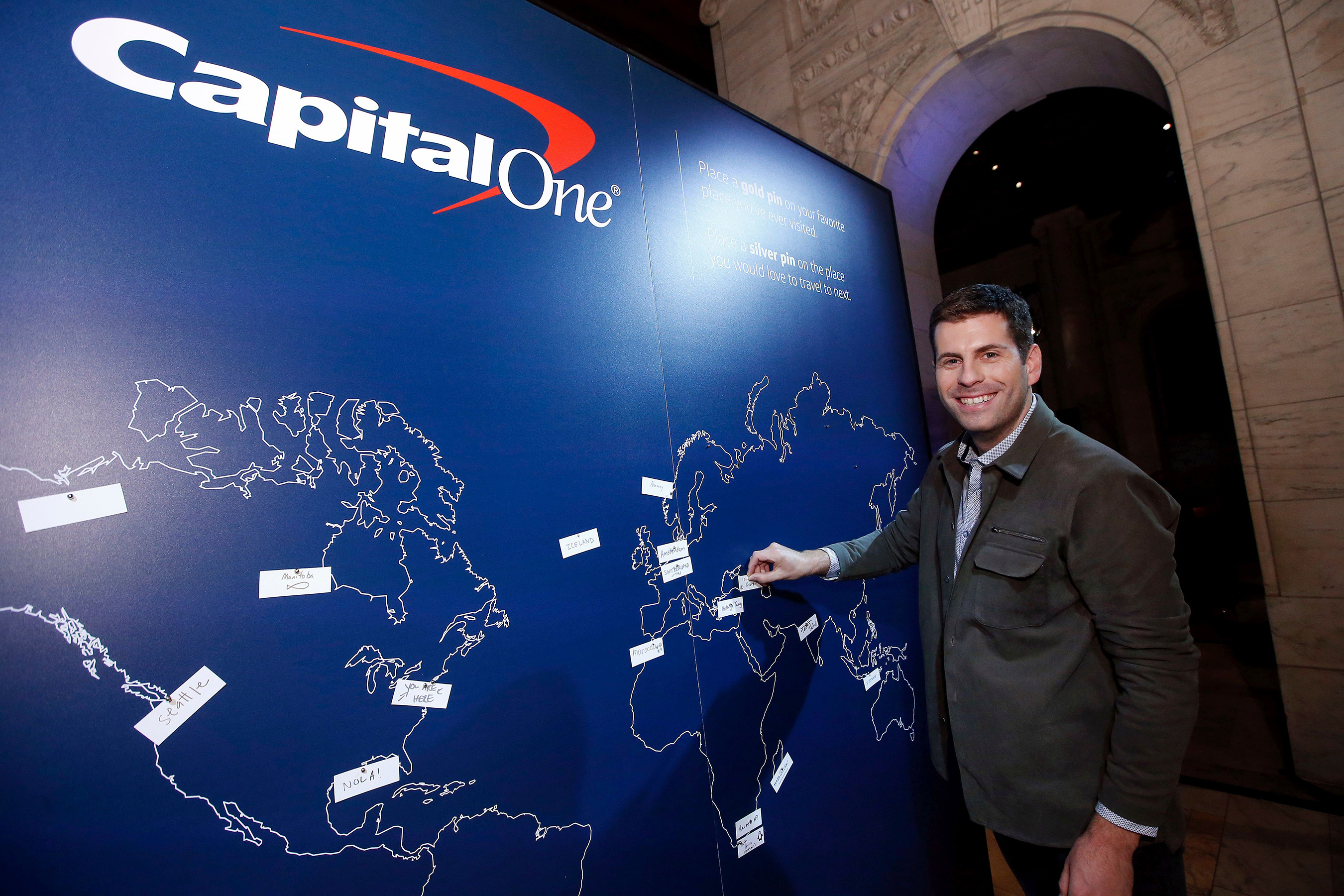 Zach Houghton of Passion Passport pins his most purposeful travel destination at a launch event for the Purpose Project(SM) by Capital One® Wednesday, October 24, 2018, in New York. (Jason DeCrow/AP Images for Capital One)