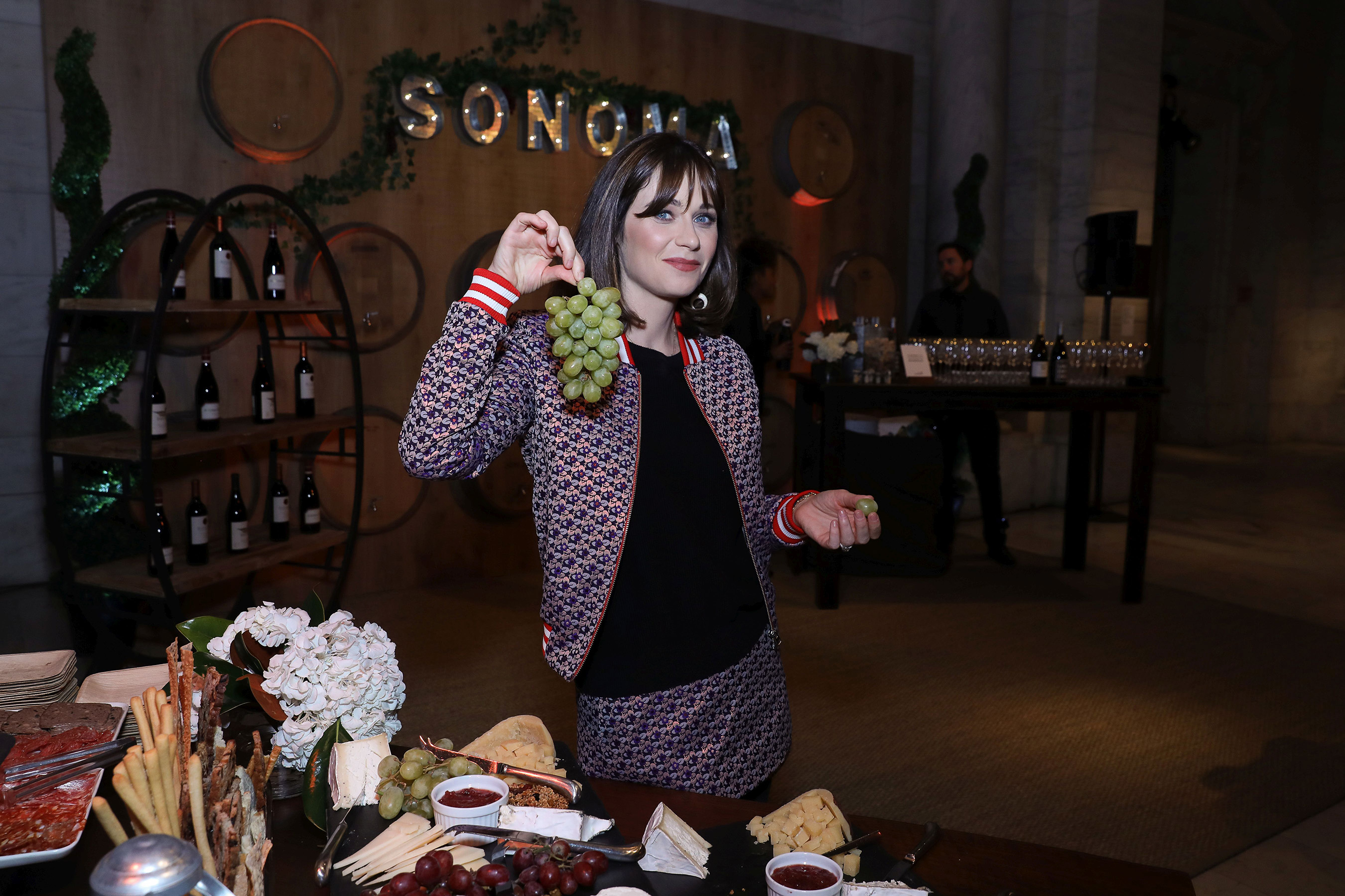Zooey Deschanel shares her passion for travel at the Sonoma pop-up experience during the launch event at Capital One's Purpose Project for the Purpose Project(SM) by Capital One® on Wednesday, October 24, 2018 in New York.(Mark Von Holden/AP Images for Capital One)