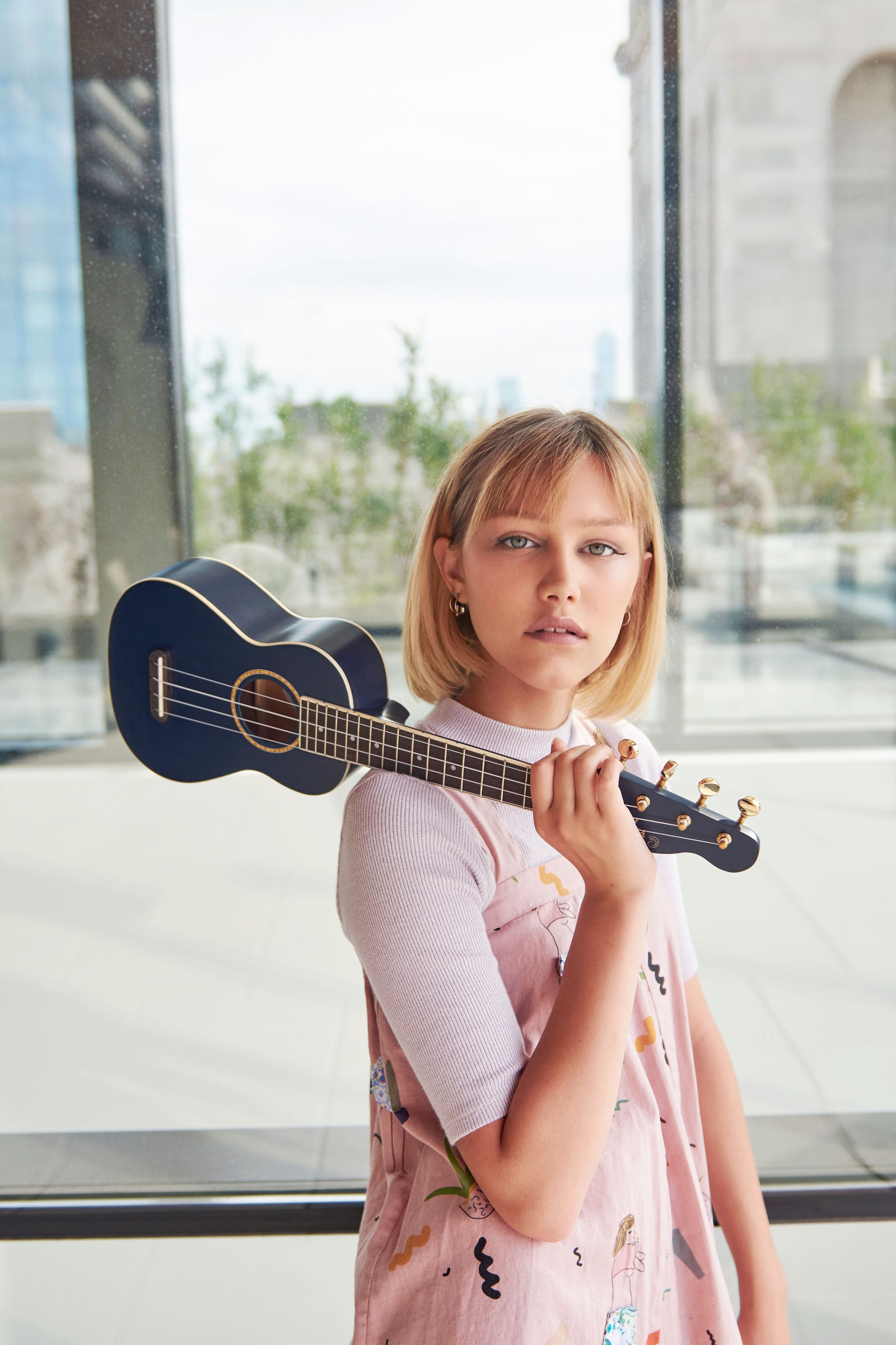Fender and Grace VanderWaal collaborate on the signature Moonlight Ukulele - a custom, accessibly priced navy-blue soprano uke adorned with all of Grace's personal touches- available now, for fans to play by the beach or at home with friends and family (photo credit: by Blythe Thomas).