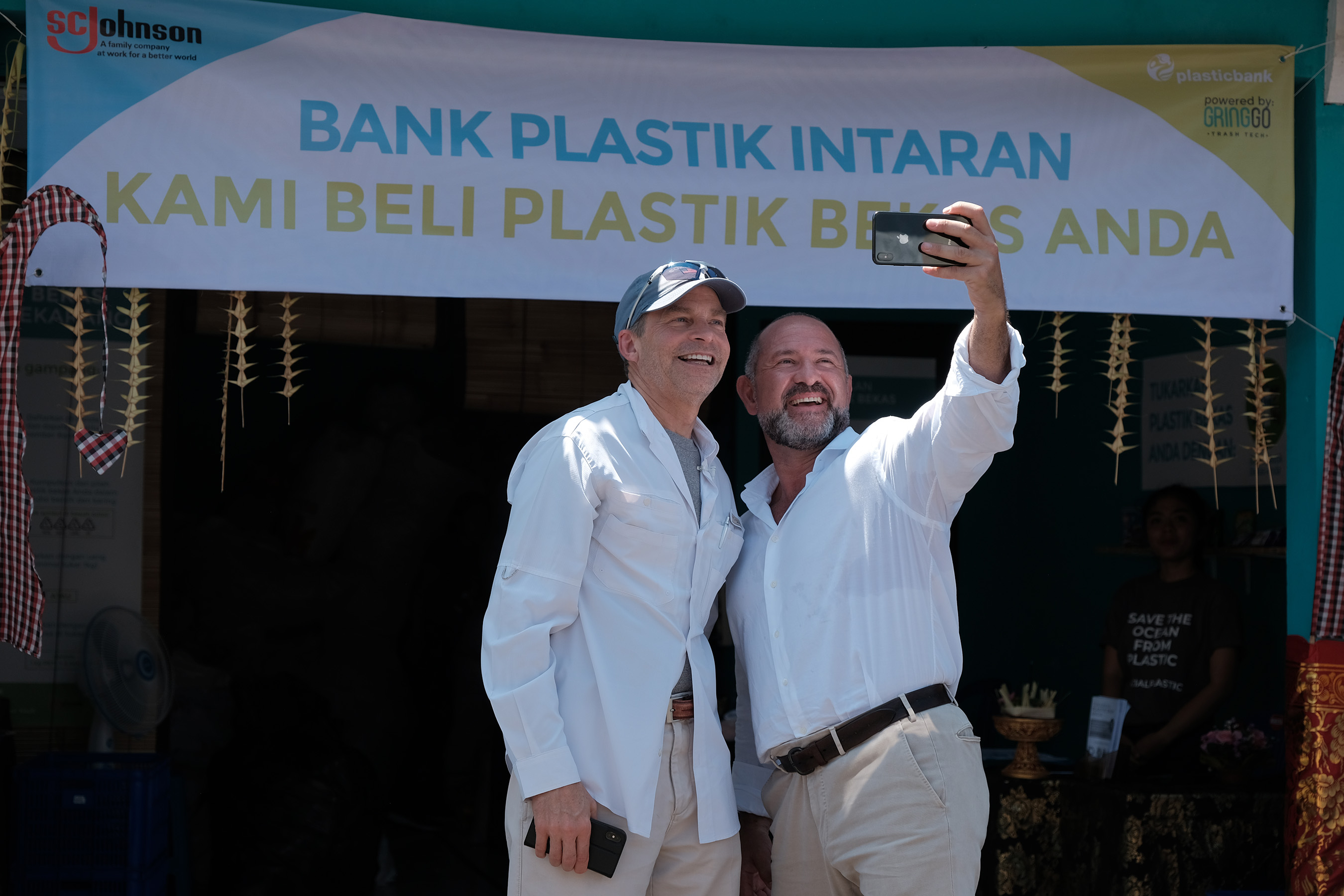 Fisk Johnson, Chairman and CEO of SC Johnson and David Katz, CEO of Plastic Bank, open the first of eight recycling centers in Indonesia