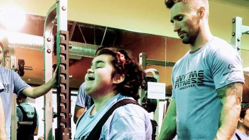 Coached and supported by trainers, Special Olympics athletes perform deadlifts at Anytime Fitness in Vancouver, WA