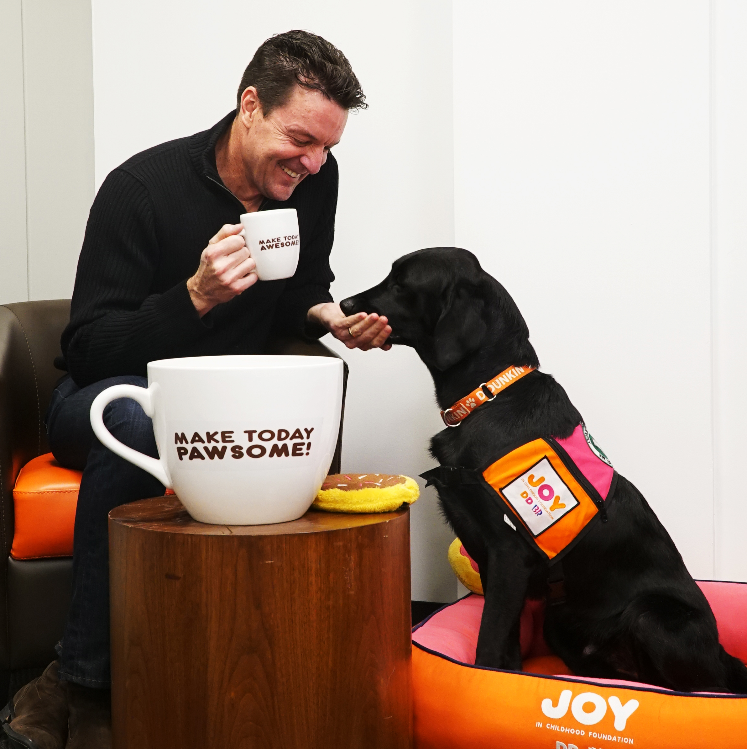 Dunkin' CEO, Dave Hoffmann having a meeting with the Chief Joy Officer, Cooper Dunkin'.