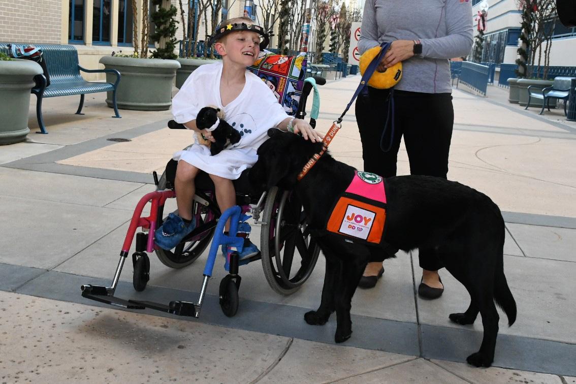 Cooper bringing joy to a patient at Cook Children's Hospital.