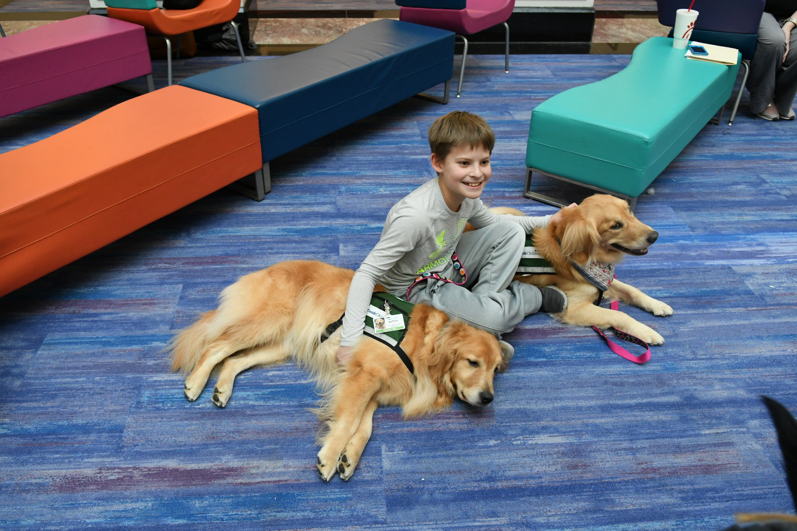 In-residence dogs doing their job to bring joy to a child undergoing treatment at Cook Children's Hospital.