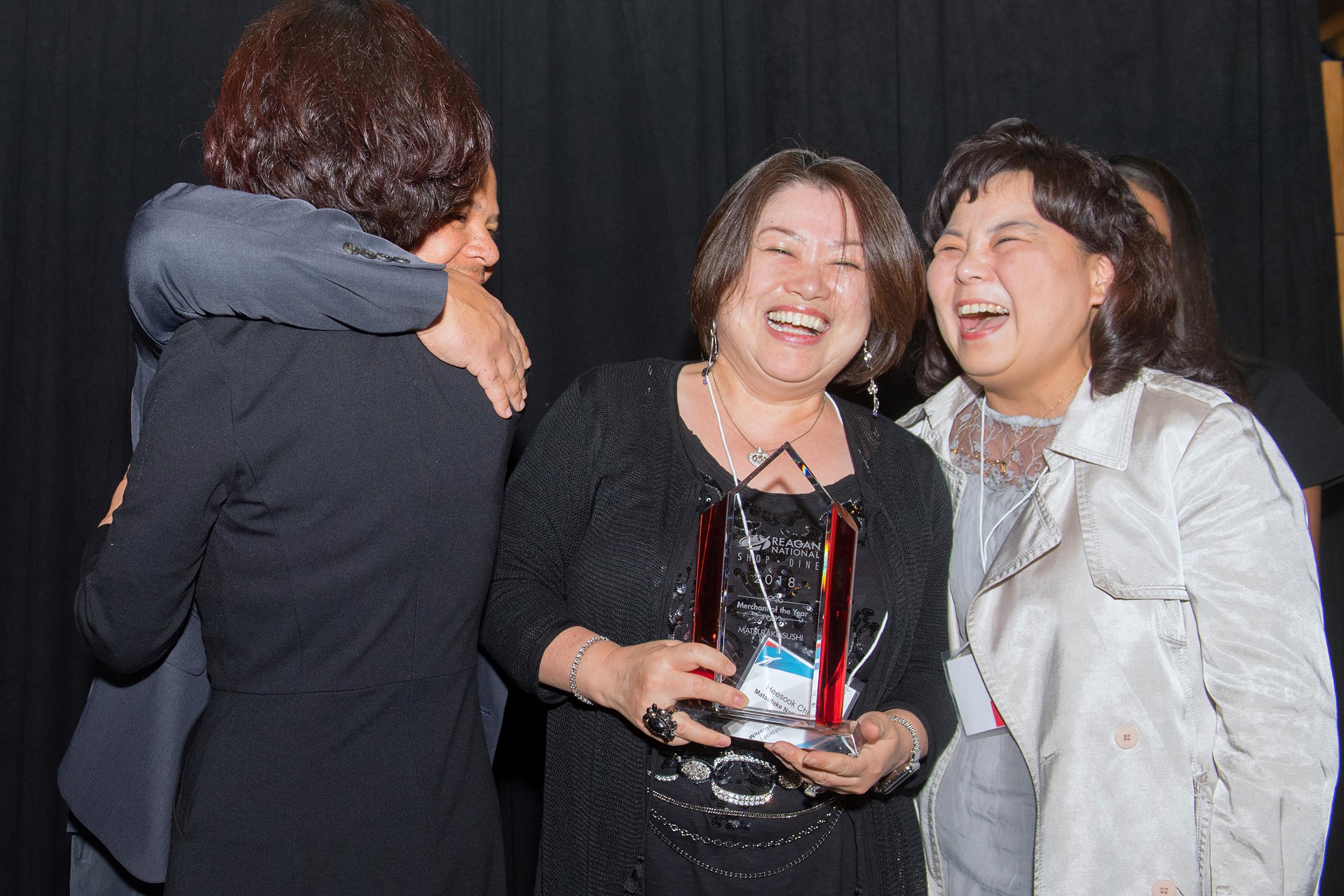 Heesook Chun, owner of Matsutake Sushi, accepting Reagan National Merchant of the Year award