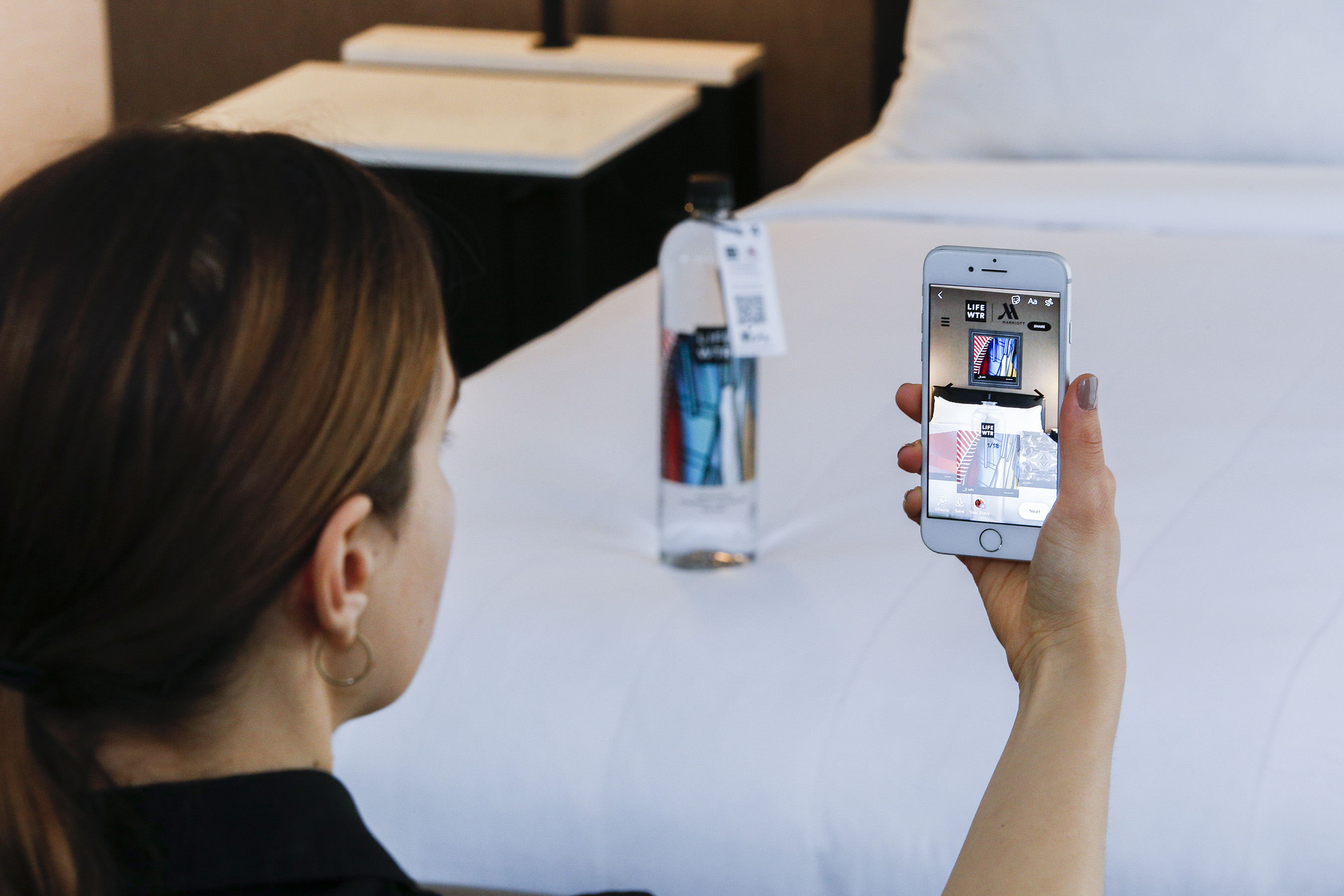 Once the code is scanned, they can customize their rooms with an AR art gallery