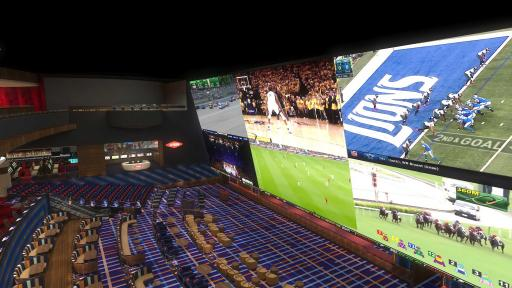 multi-level, stadium-style sportsbook, equipped with large screens
