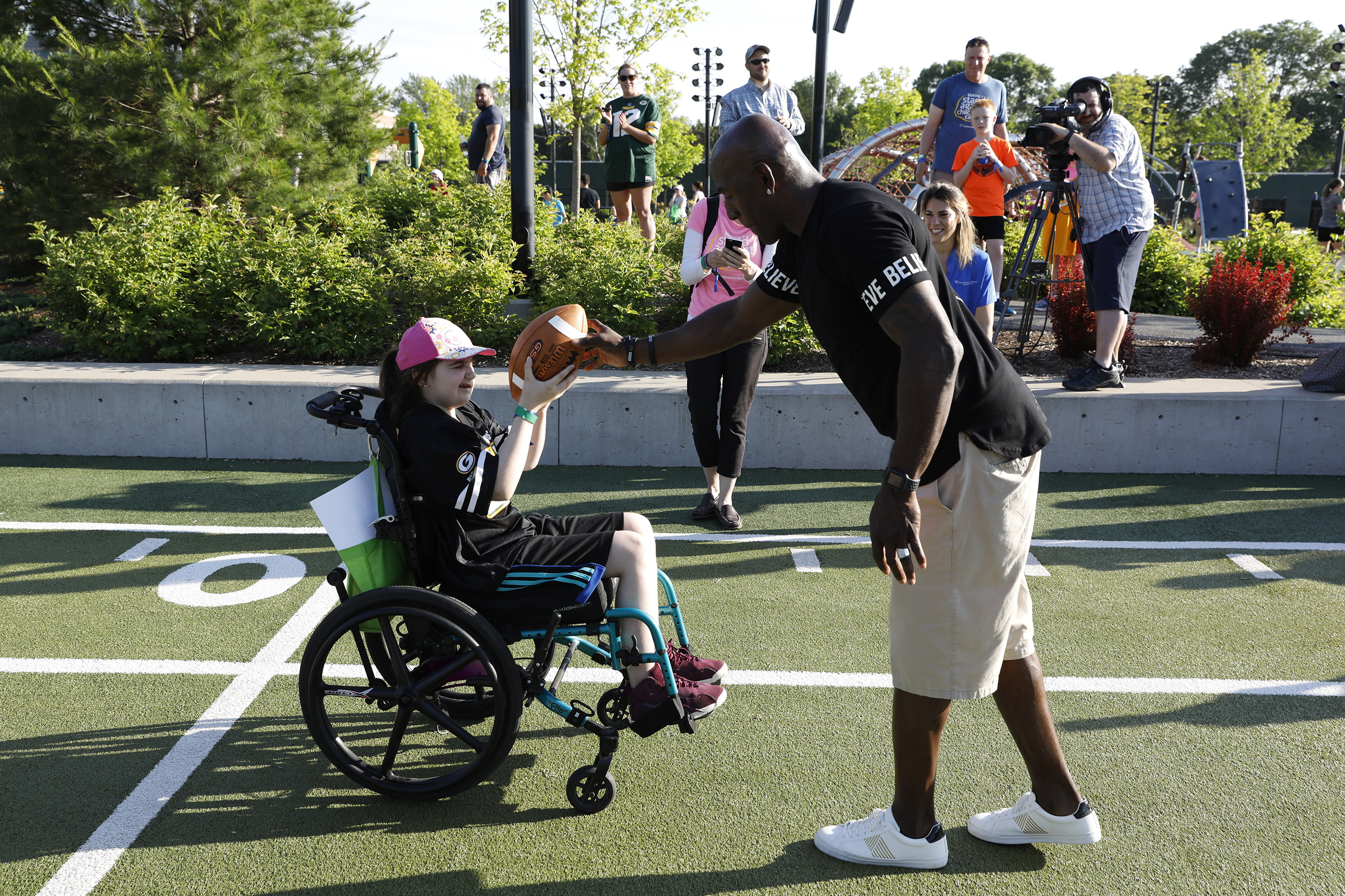 NFL legend Donald Driver interacts with children at Northwestern Mutual's Ultimate Campout Fighting Childhood Cancer at the Green Bay Packer's Titletown development.