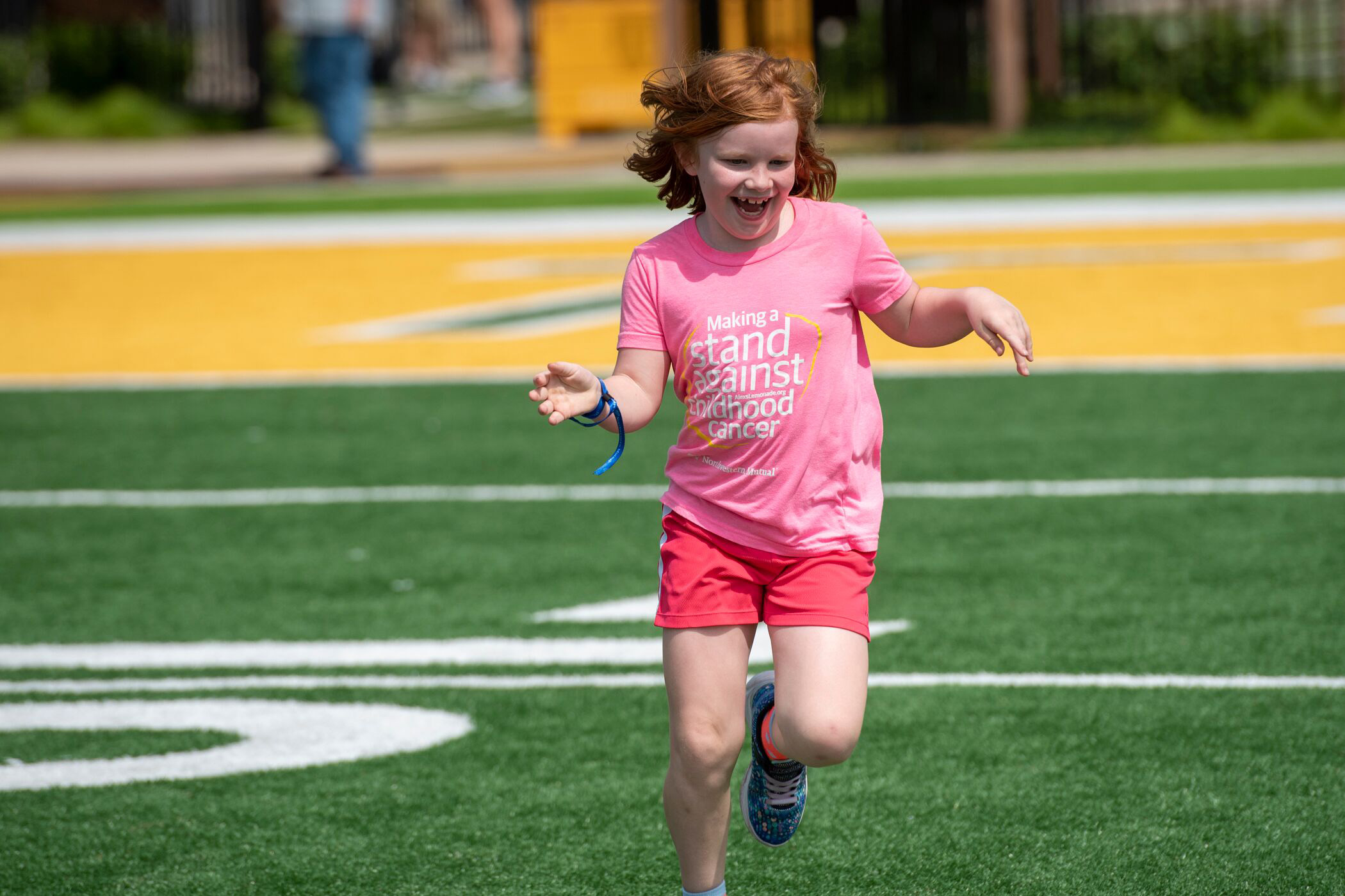 Northwestern Mutual's Ultimate Campout Fighting Childhood Cancer: When kids fighting cancer can just be kids– nothing is more special. Children and families race down the field at the Green Bay Packer's Titletown development.