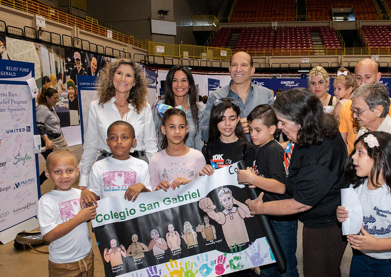 Howard Lutnick, Cantor Fitzgerald Chairman & CEO, Edie Lutnick, President of Cantor Fitzgerald Relief Fund and Allison Lutnick, Director of Disaster Relief Efforts, are photographed with students and administrators of the San Gabriel School of the Deaf.