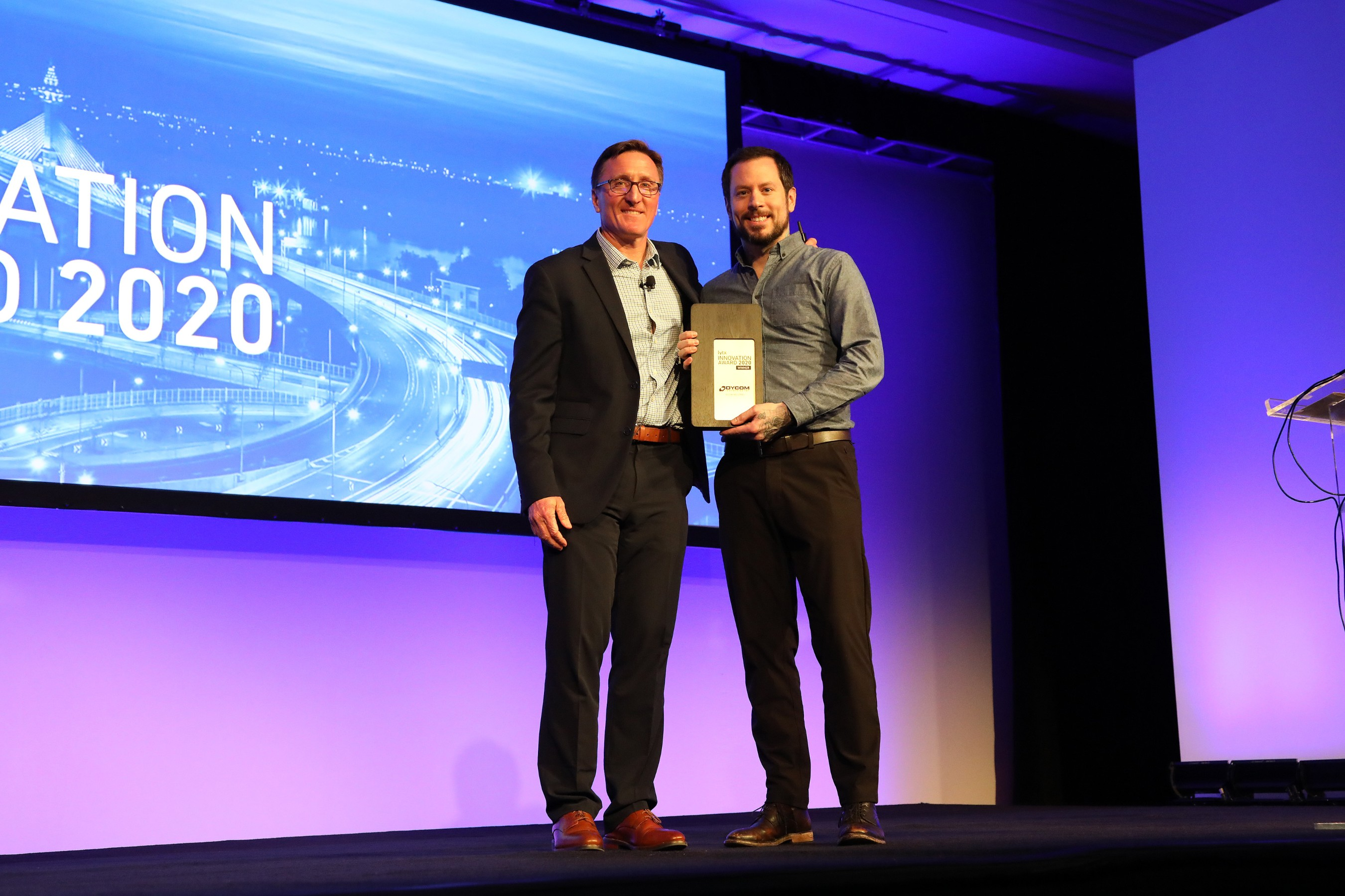 Matt Lovato, Senior Manager, Safety, Dycom Industries, Inc. accepts Lytx inaugural 2020 Lytx Innovation Award from David Riordan, Lytx EVP and Chief Client Officer, at Lytx's User Group Conference. Dycom is a co-winner of the award, with MV Transportation