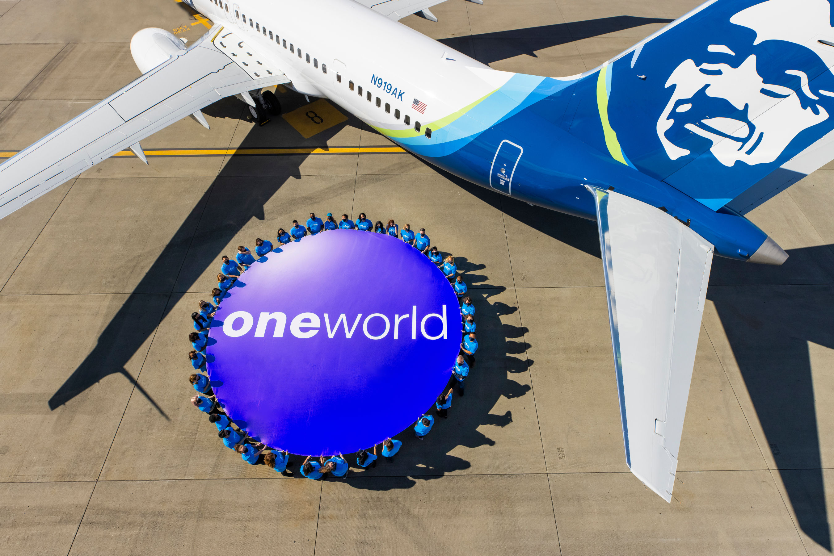 Alaska Airlines' employees celebrate the airline officially joining the oneworld family.