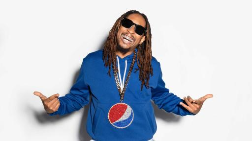 Lil Jon jumping while holding a can of Pepsi