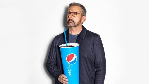 Steve Carell holding an oversize cup of Pepsi