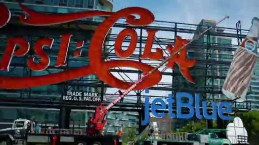 Boomerang: Installation of the temporary JetBlue signage placed on the landmark Pepsi-Cola sign in Long Island City, New York.