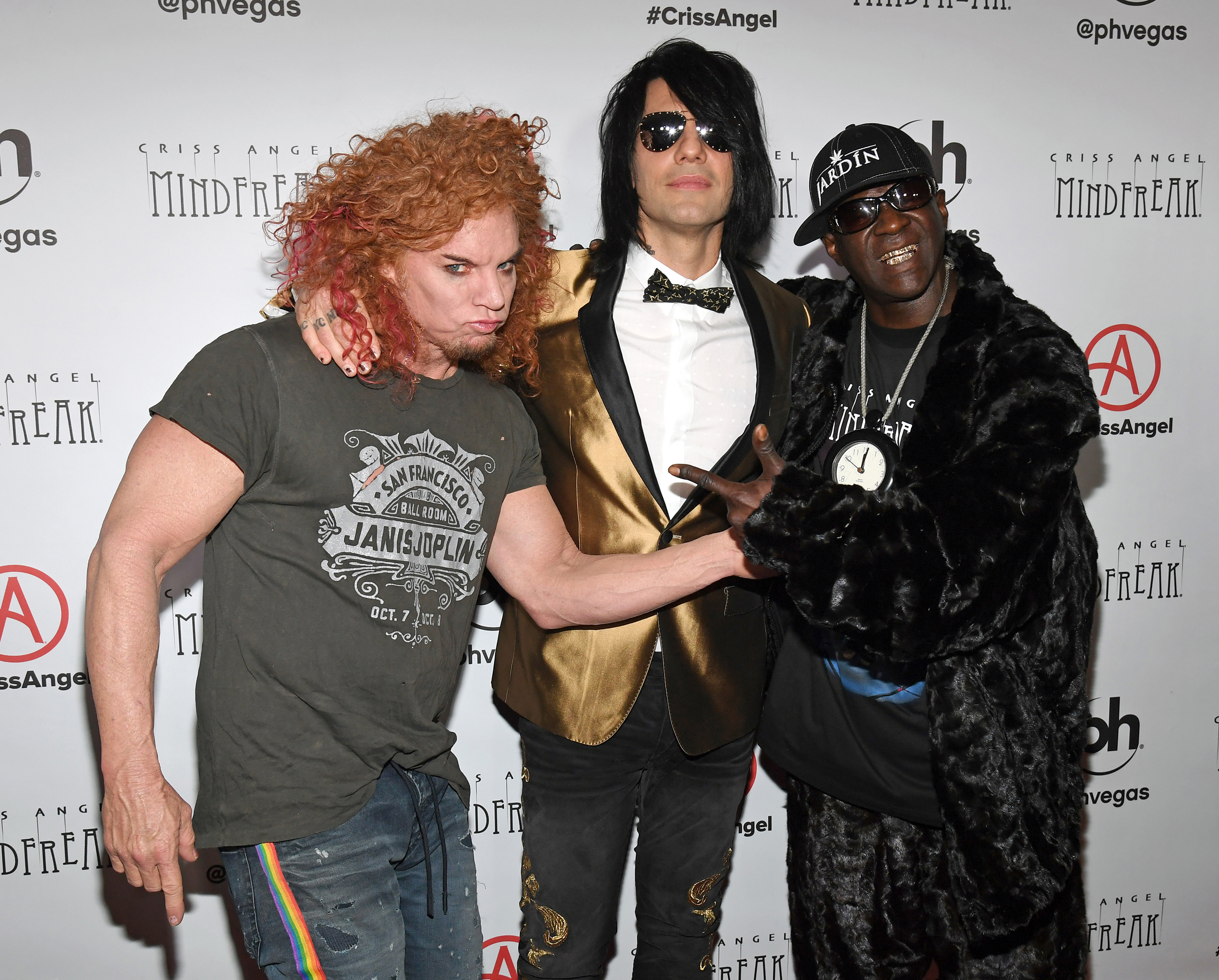 (L-R) Comedian Carrot Top, illusionist Criss Angel and rapper Flavor Flav attend the grand opening of Criss Angel MINDFREAK at Planet Hollywood Resort & Casino on January 19, 2019 in Las Vegas