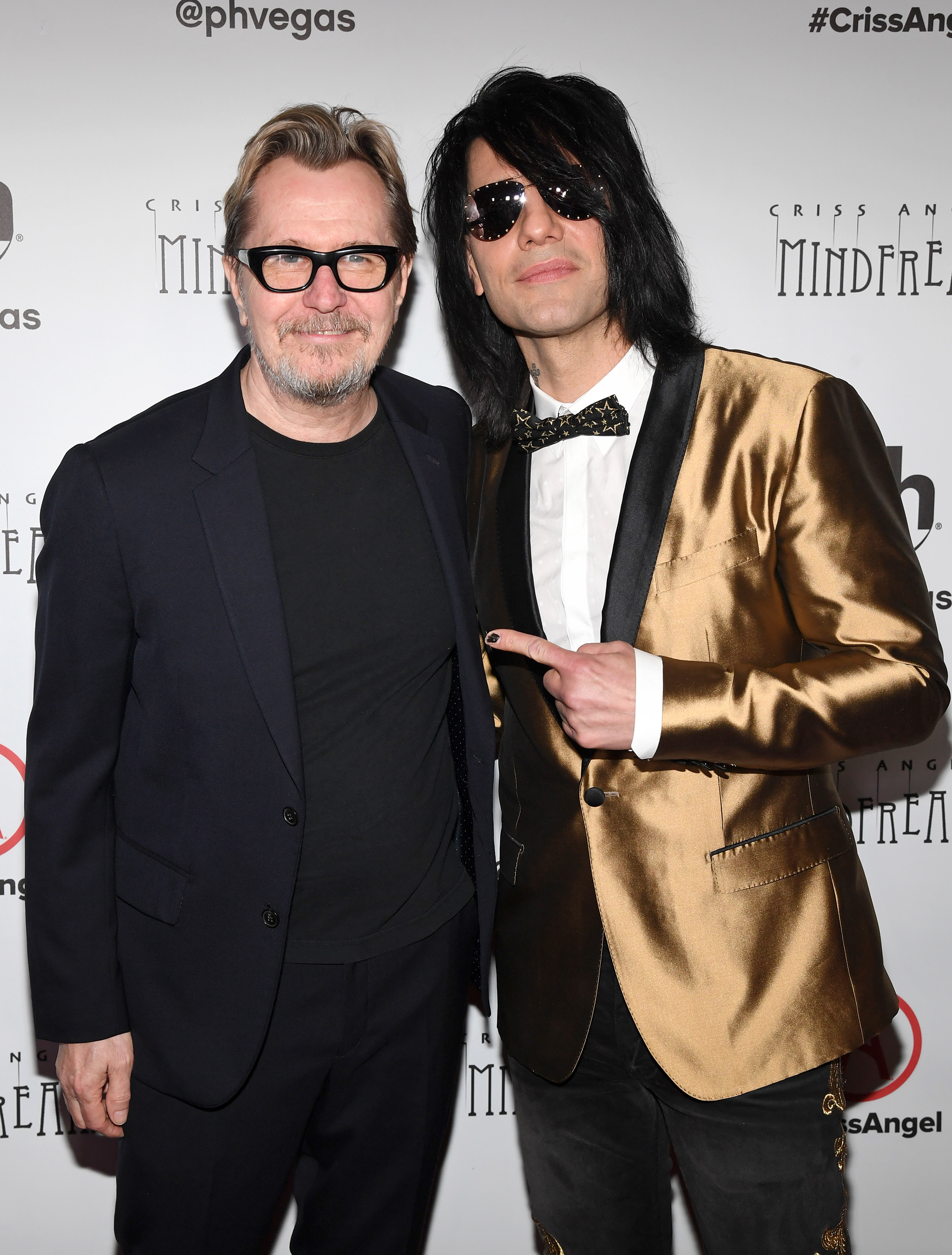 Actor Gary Oldman (L) and illusionist Criss Angel attend the grand opening of Criss Angel MINDFREAK at Planet Hollywood Resort & Casino on January 19, 2019 in Las Vegas
