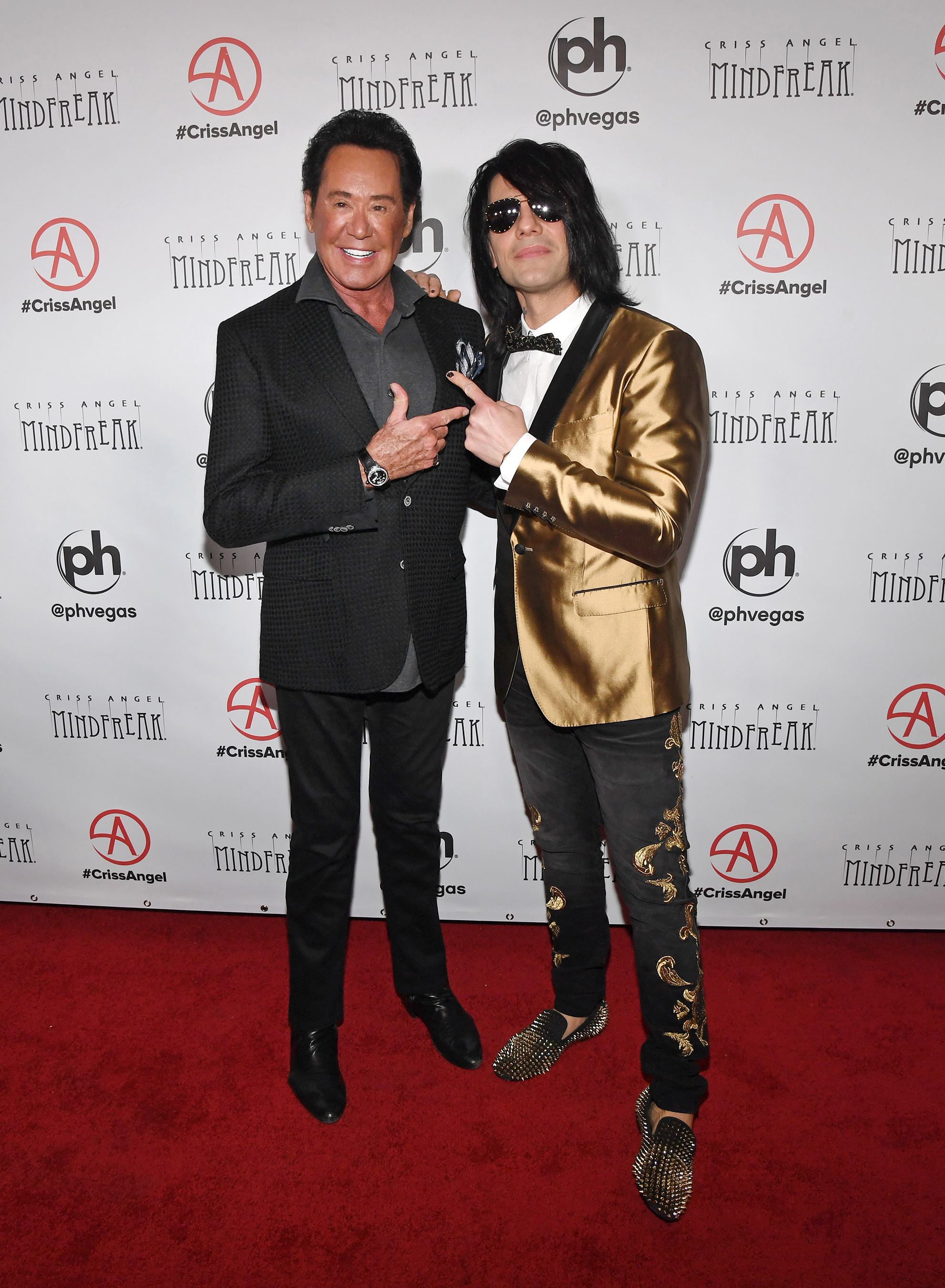 Entertainer Wayne Newton (L) and illusionist Criss Angel attend the grand opening of Criss Angel MINDFREAK at Planet Hollywood Resort & Casino on January 19, 2019 in Las Vegas