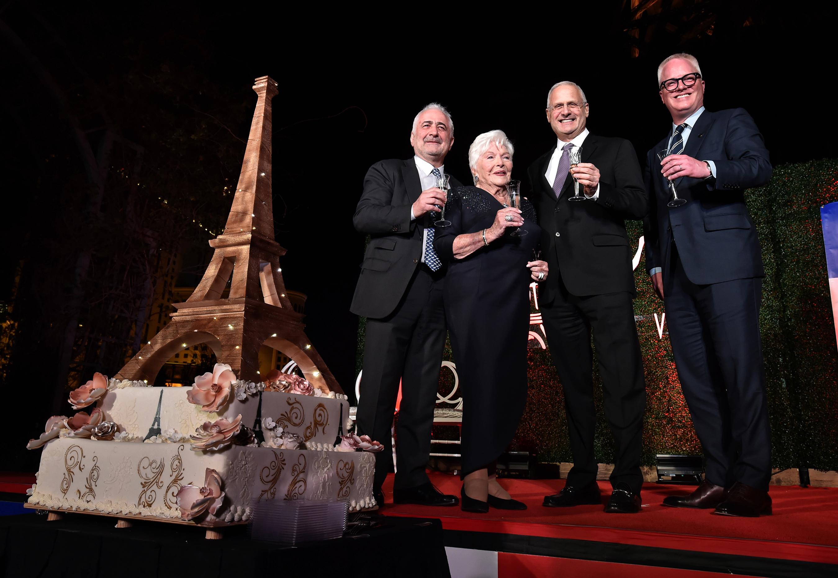 L-R: Chef Guy Savoy, Line Renaud, President of Paris Las Vegas Gary Selesner and EVP & CMO of Caesars Entertainment Chris Holdren toast to the new Eiffel Tower lights. (Courtesy of Paris Las Vegas)
