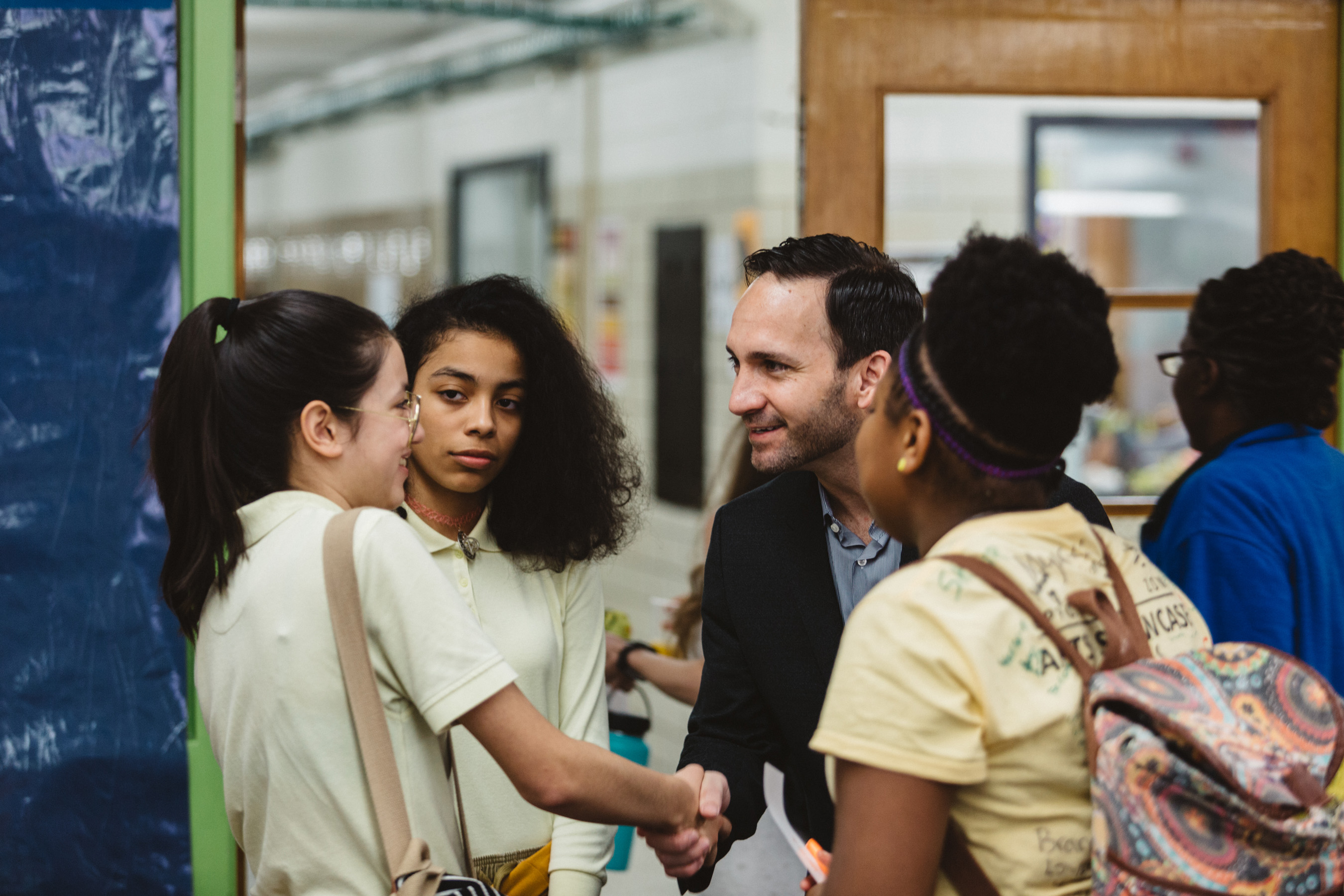Krystal CEO Paul Macaluso greets students at Orchard Knob Middle School in Chattanooga, Tennessee.