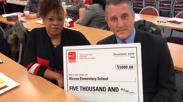 Atlanta's Alcova Elementary School Principal accepts check for $5,000 from The Krystal Foundation on behalf of students. Funds will be used for 3D printing and STEAM activities. Thanks, Krystal!