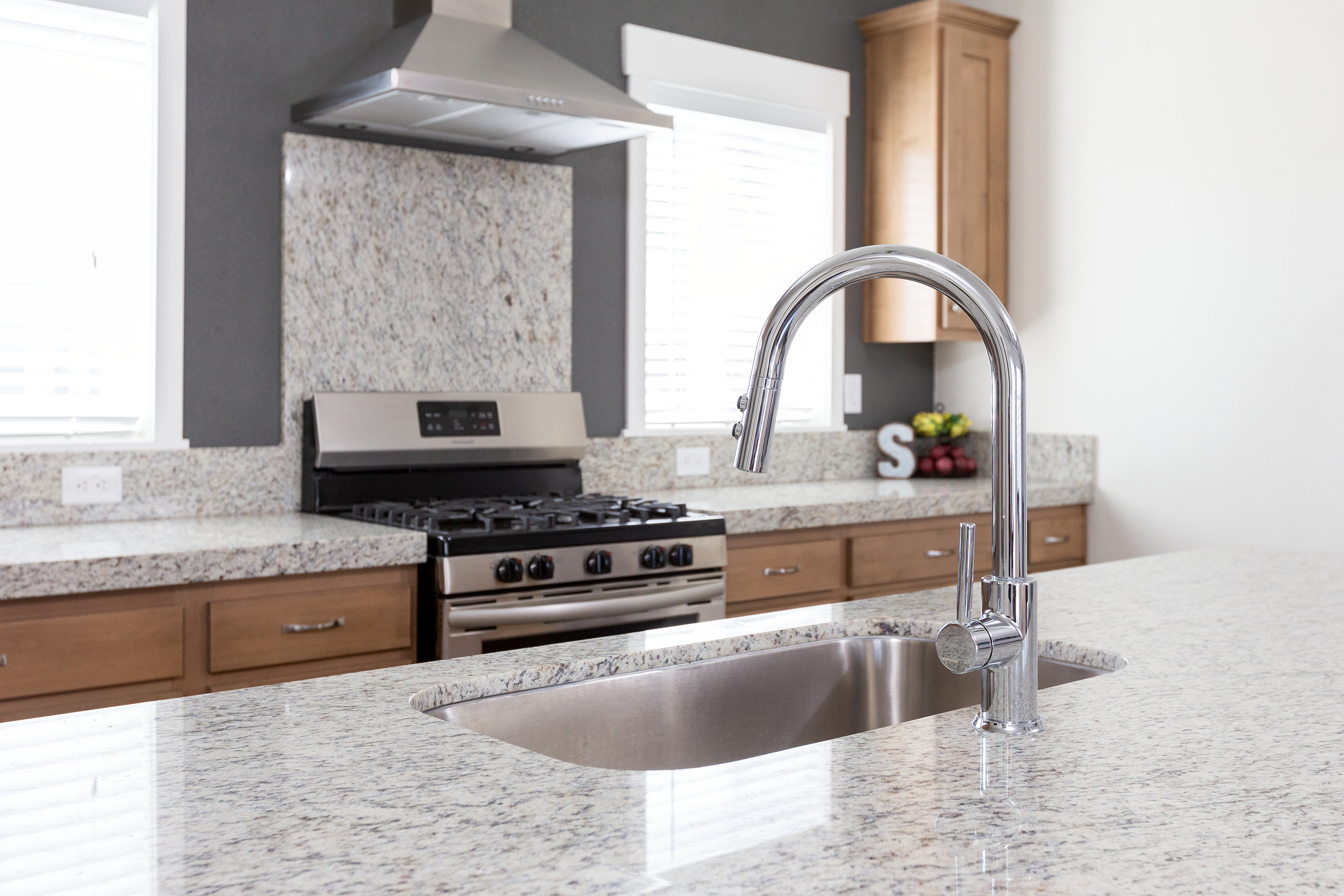 Pfister Faucets will be featured in Clayton Built® kitchens and bathrooms.