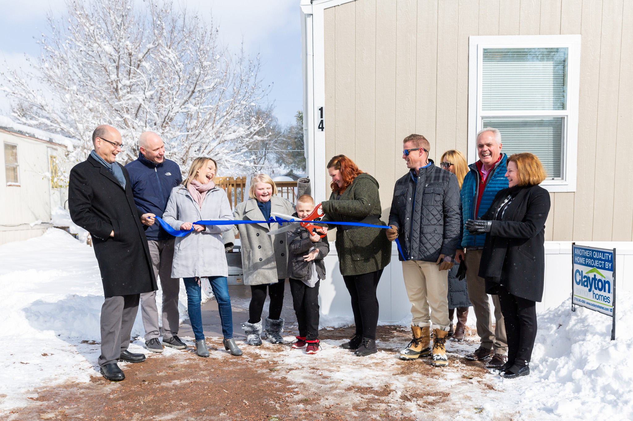 In October 2019, a ribbon-cutting ceremony marked the celebration of the Warren family's milestone as new homeowners.
