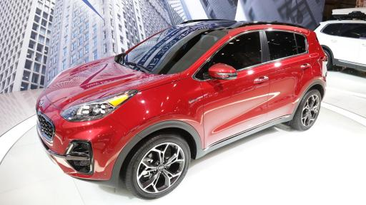 A red 2020 Kia Sportage at the auto show