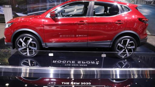 A side profile of a Nissan Rogue Sport at the auto show
