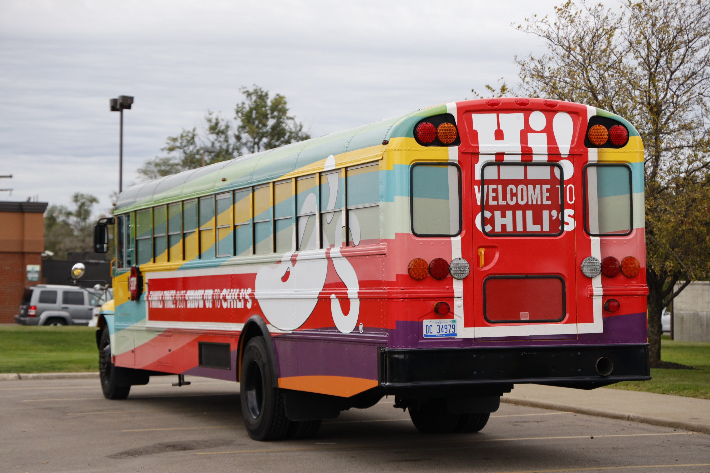 Chili's surprise and delights loyalty families at after school pick-up and dinner for a memorable afternoon on the custom Chili's school bus!
