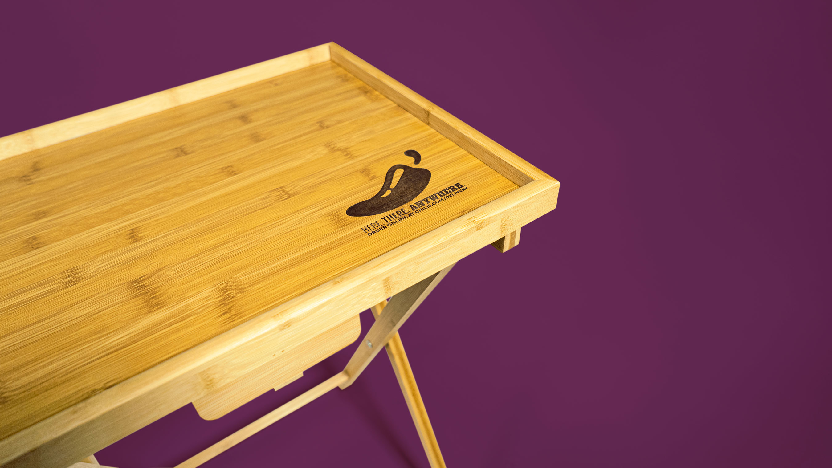 This wooden TV tray can handle just about anything so you don't have to hold it all in your lap!