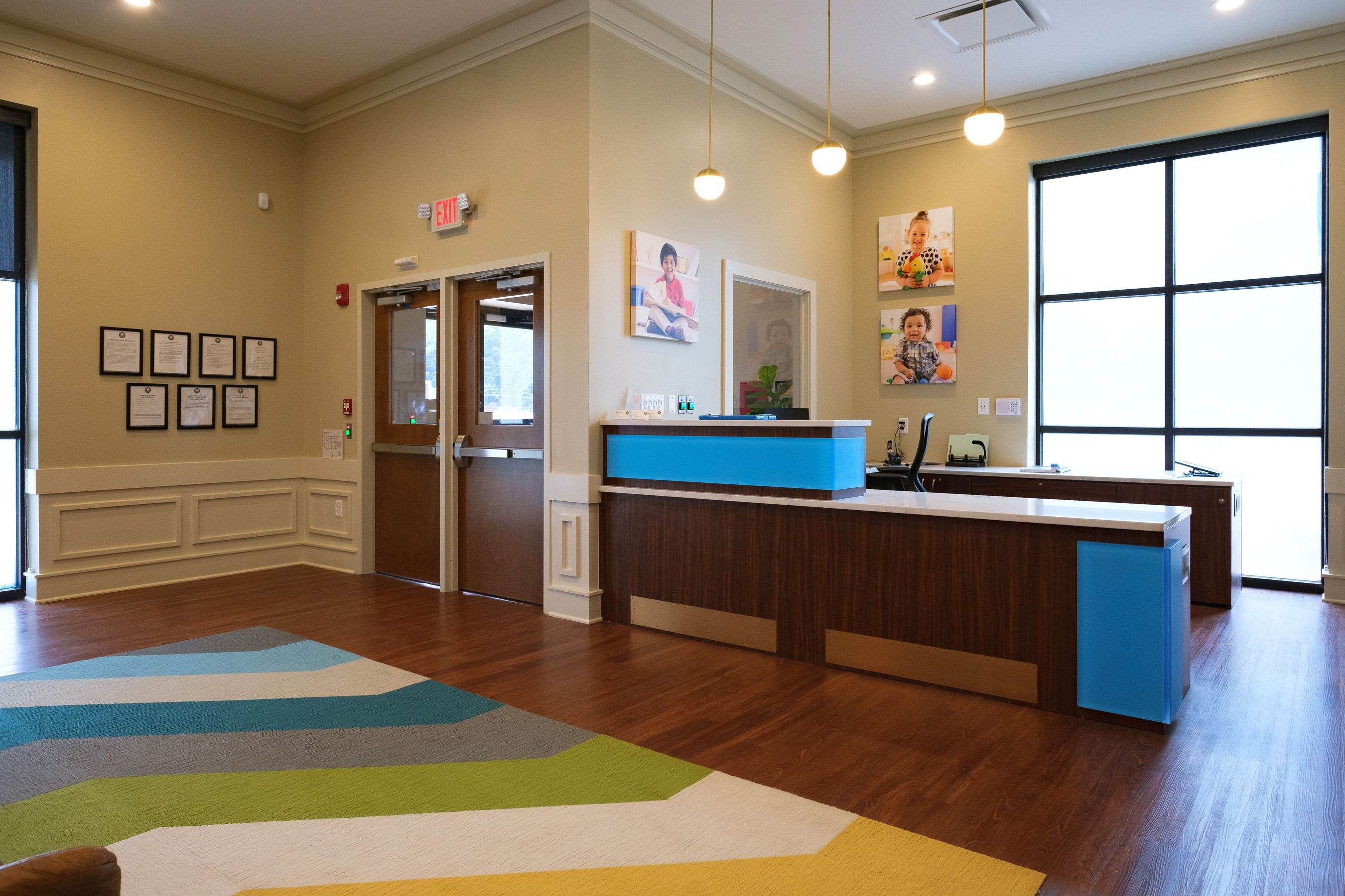 Parents will drop off and pick up their child at of Primrose School of Atlanta Westside in the open-concept lobby.