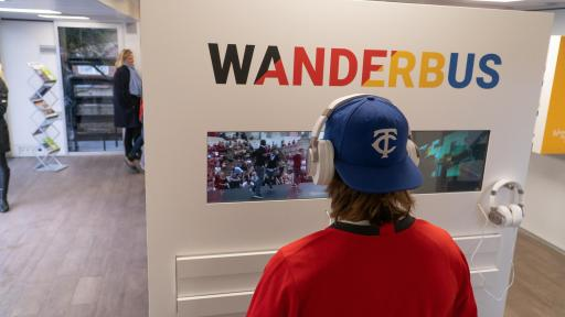 Person watching WanderbUS video