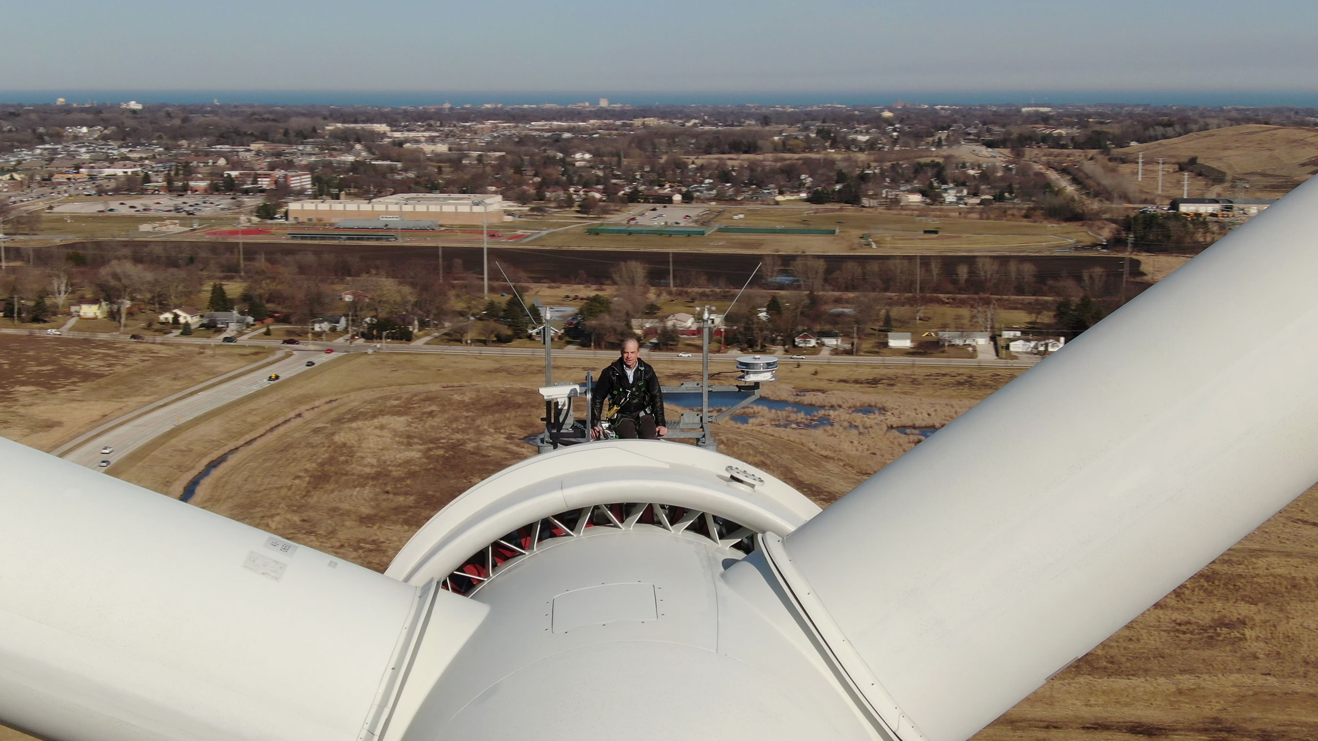 Fisk Johnson stands atop a 415-foot wind turbine at SC Johnson's largest factory.