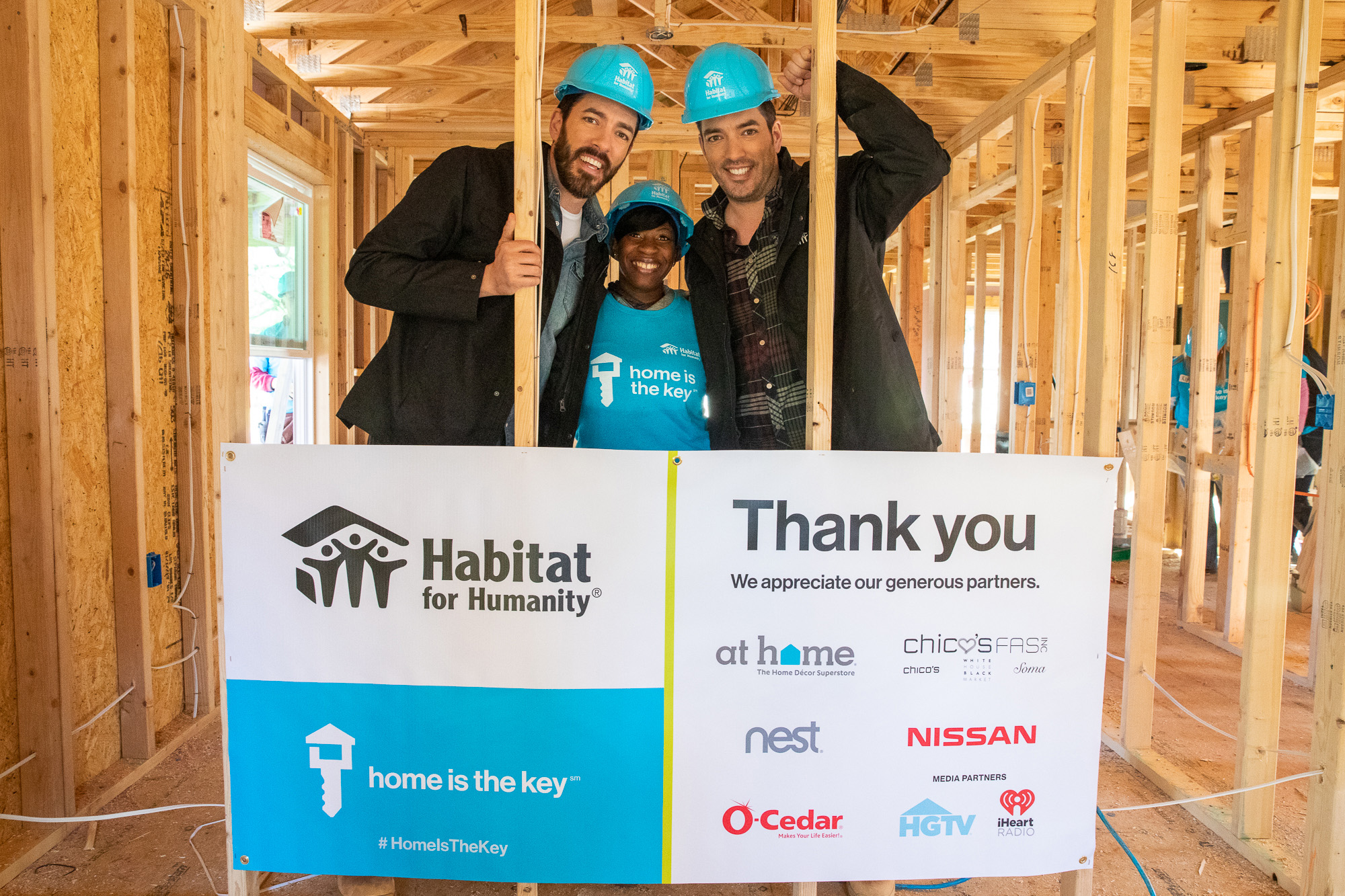 Habitat Humanitarians Drew and Jonathan Scott join future homeowner Krushetta to help build her house during Habitat for Humanity's Home is the Key campaign launch in Atlanta.