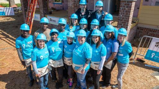 A group of people working with Habitat for Humanity.