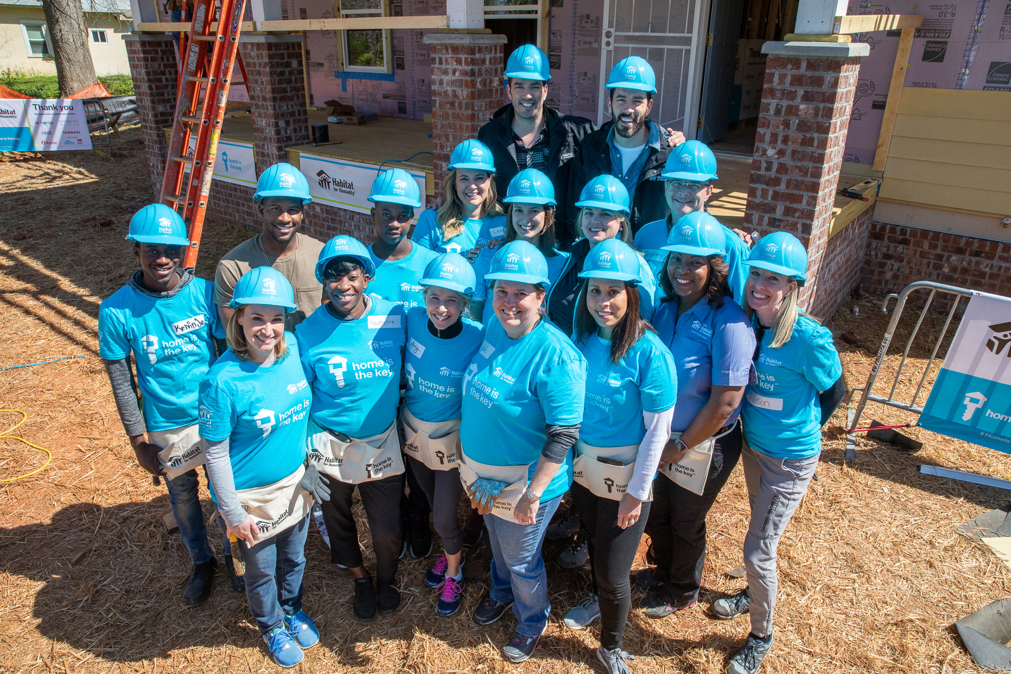 Future Habitat homeowner Krushetta and her sons with Habitat Humanitarians Drew and Jonathan Scott, along with Habitat staff and volunteers from Home is the Key partners Chico's FAS, Inc., Nest (a Google brand), Nissan and O-Cedar.