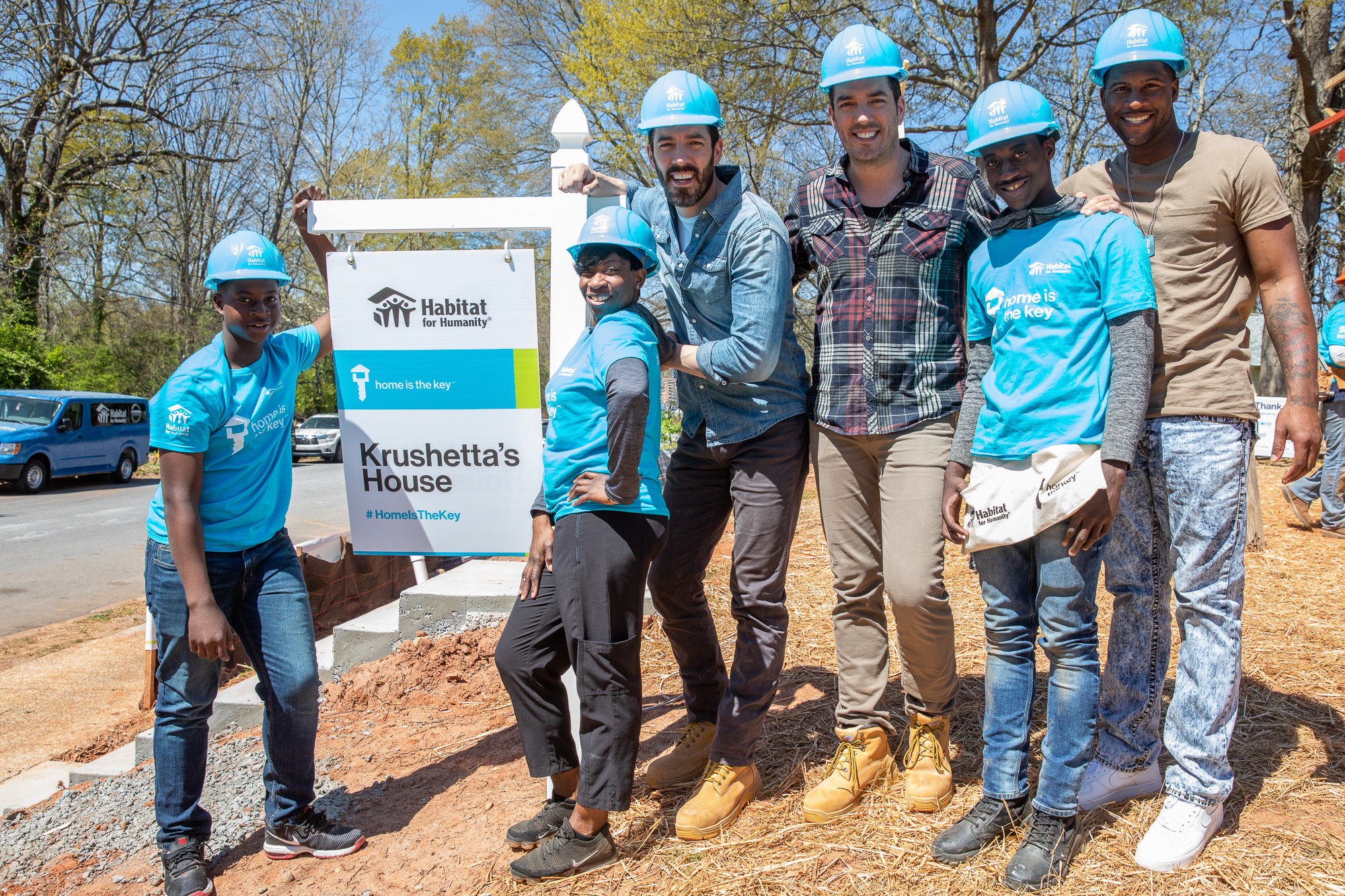 Habitat Humanitarians Drew and Jonathan Scott join Krushetta and her sons Kelton, Kelvin and Marquel at the site of their future Habitat for Humanity home in Atlanta.