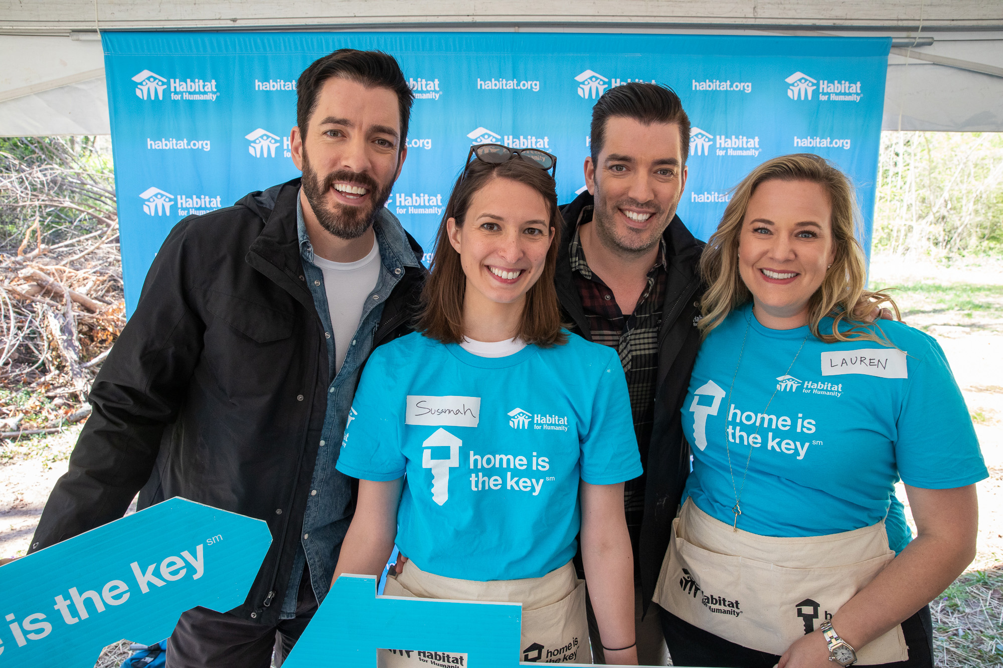 Volunteers with Nest, a Google brand, join Drew and Jonathan Scott at the launch of the Home is the Key campaign in Atlanta.